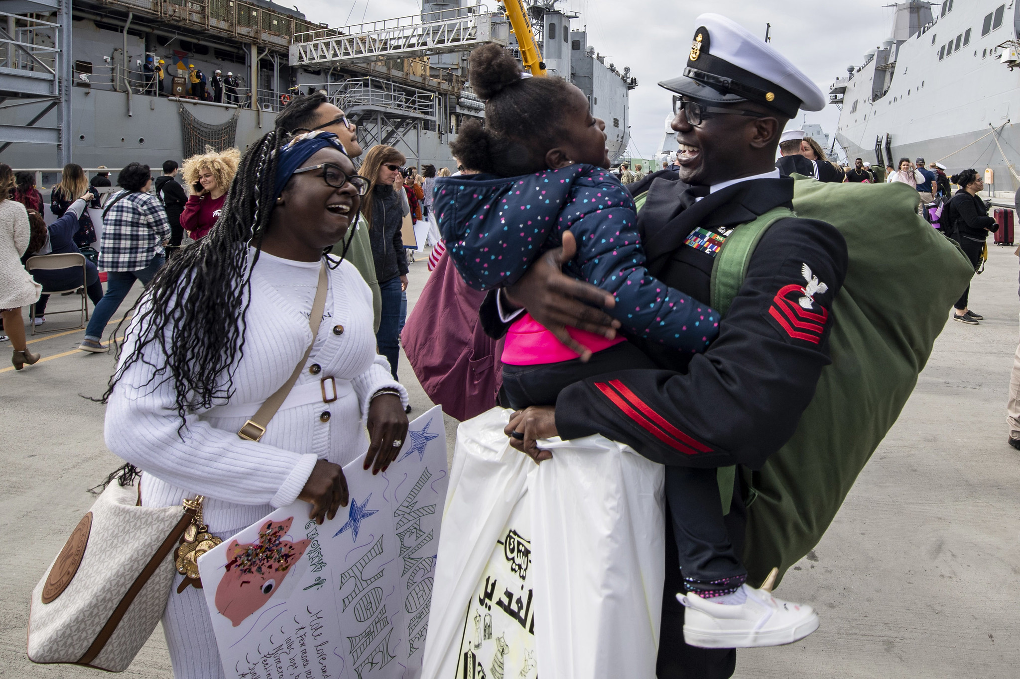 Chief Personnel Specialist Jonathan Kwakye, assigned to the amphibious transport dock ship USS John P. Murtha (LPD 26), reunites with his family Nov. 27, 2019, during a homecoming gathering at Naval Base San Diego. (Mass Communication Specialist 2nd Class Kyle Carlstrom/Navy)