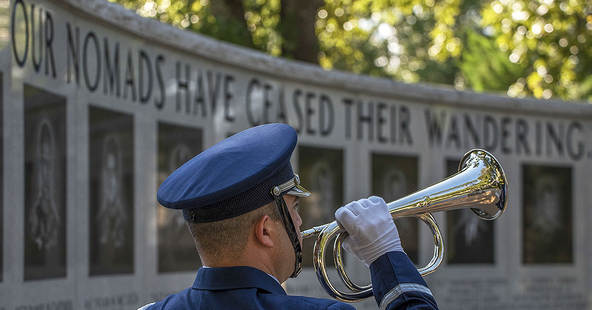 Staff Sgt. Christopher Morris, Air Force honor guardsman, holds a trumpet as Taps is played during a Khobar Towers Memorial Ceremony June 25, 2018, at Eglin Air Force Base, Fla. (Staff Sgt. Peter Thompson/Air Force)