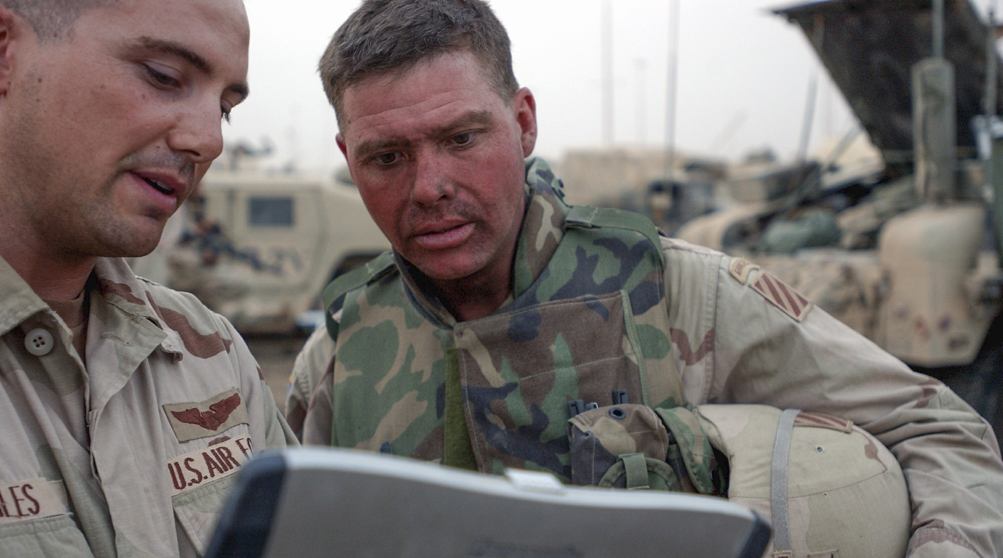 Col. David Perkins receives an update on day 18 during the invasion of Iraq in March 2003. (Army)
