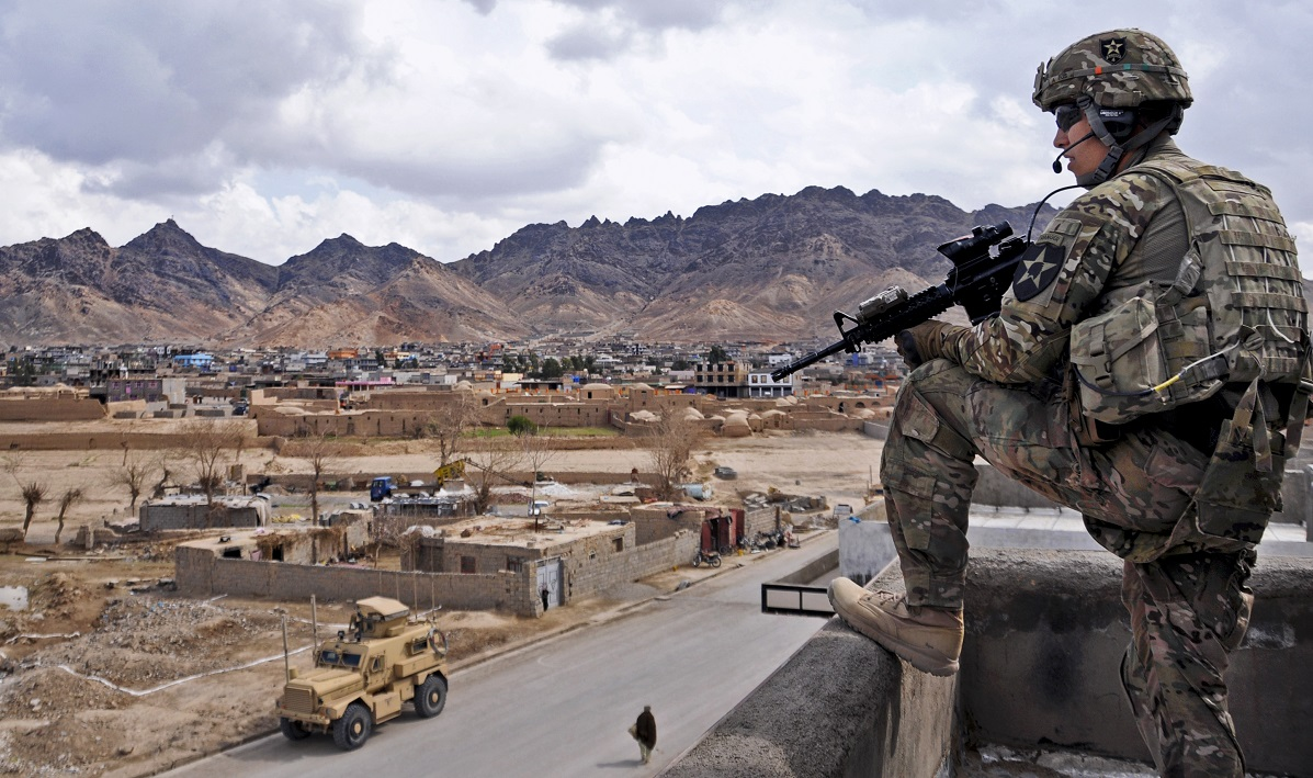 U.S. Army 1st Lt. Robert Wolfe, security force platoon leader for Provincial Reconstruction Team Farah, provides rooftop security during a key leader engagement in Farah City, Afghanistan. (Lt. j.g. Matthew Stroup/U.S. Navy)