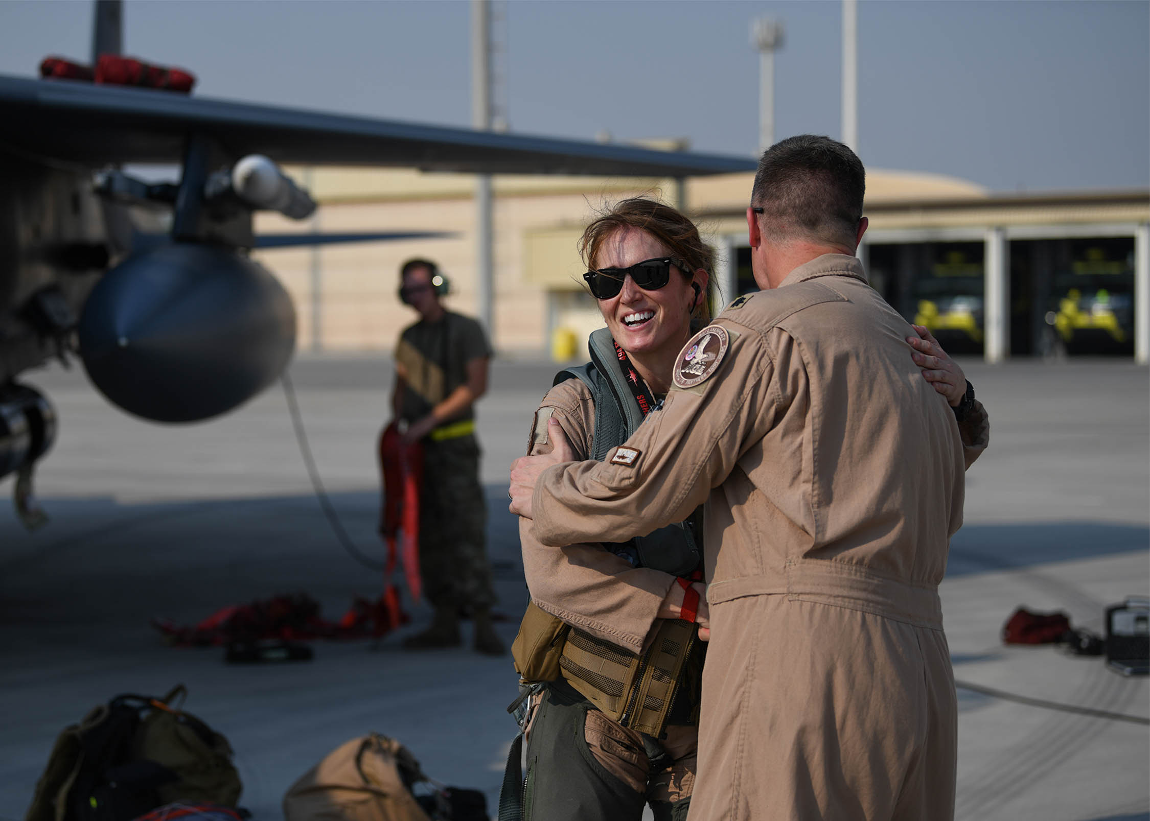 Lt. Col. Jaina Donberg, 494th Fighter Squadron commander, greets Lt. Col. Ryan Lippert, 494th FS assistant director of operations, Oct. 21 after arriving at Al Dhafra Air Base, United Arab Emirates. (Staff Sgt. Anna-kay Ellis/Air Force)