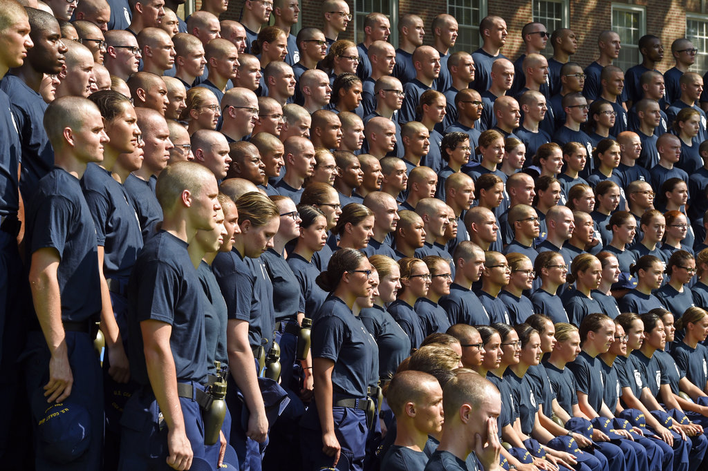 Members of the U.S. Coast Guard Academy Class of 2022 pose for their class photo on day one of Swab Summer on July 2, 2018, at the academy in New London, Conn. The seven-week Swab Summer introduces the newest class to military academy life. (Sean D. Elliot/The Day via AP)