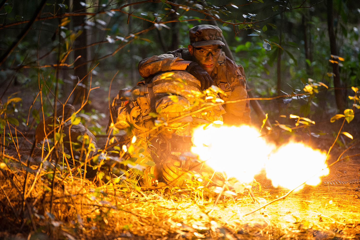 Staff Sgts. Jose Obregon and Joseph Pace, Ranger Assessment Course students, fire on opposing forces during a simulated react to contact near Schofield Barracks, Oahu, Hawaii, May 23, 2019. Twenty-three airmen from across the Air Force recently converged on a training camp for a three-week Ranger Assessment Course May 12-31, 2019. (Staff Sgt. Hailey Haux/AIr Force)