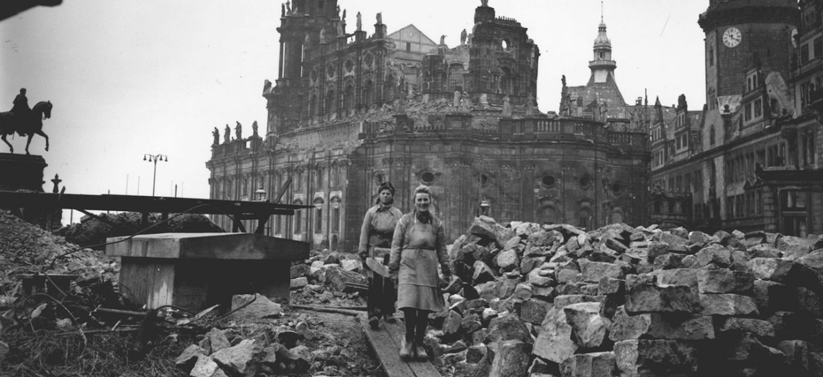 Women workers remove debris from the shell of the Hof Kirche, the Catholic cathedral in Dresden, Germany, February 1946. (Fred Ramage/Keystone/Getty Images)