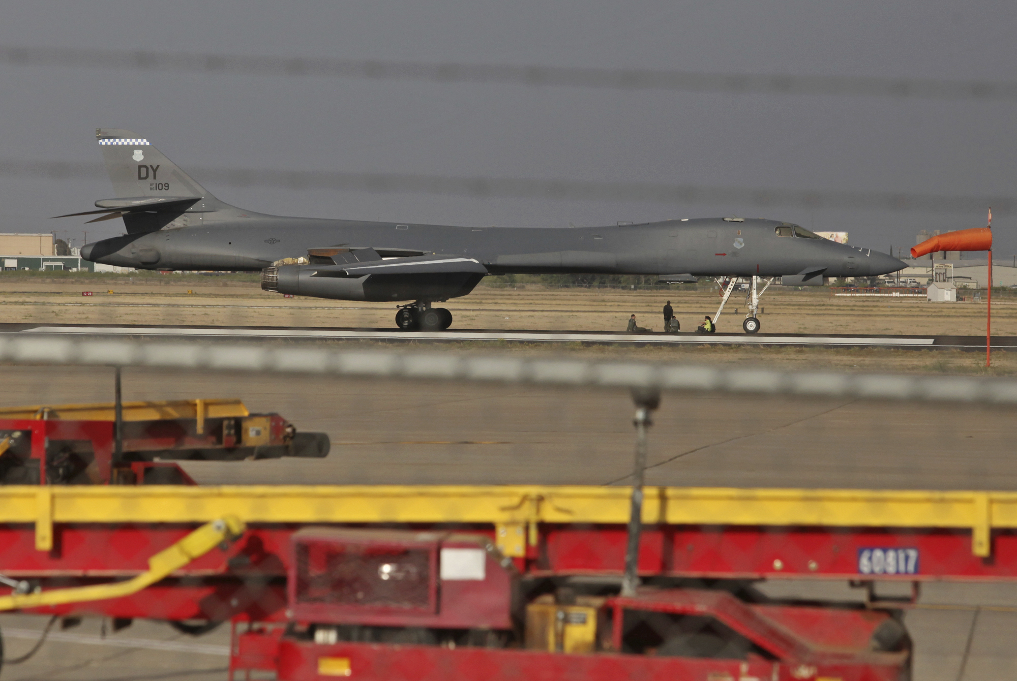 The B-1 Lancer after making an emergency landing at Midland International Air and Space Port, May 1, 2018, also showing the missing emergency hatch. The aircraft is a supersonic variable-sweep wing, heavy bomber used by the United States Air Force. (Jacob Ford/Odessa American via AP)
