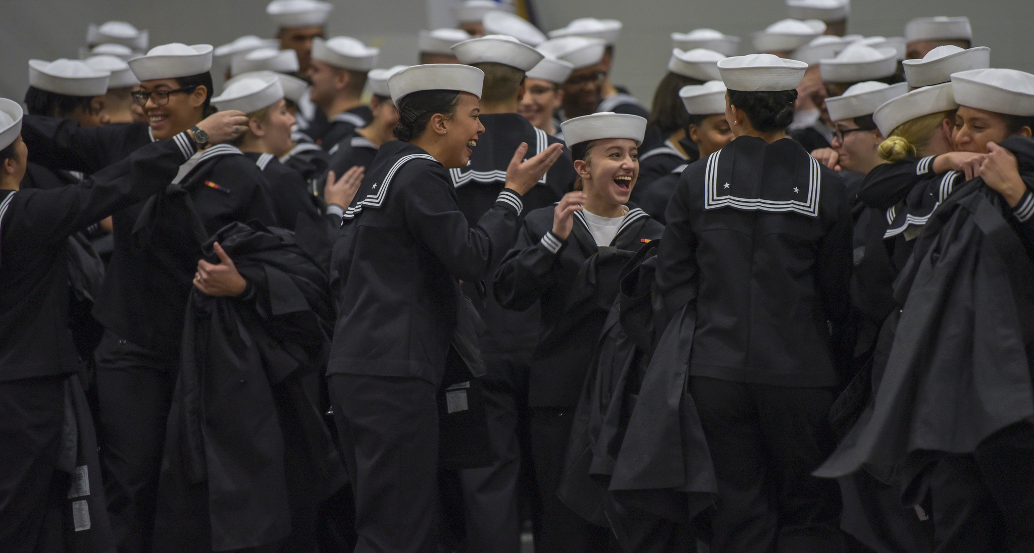 Sailors celebrate after graduating from Recruit Training Command on Jan. 4, 2019, at Great Lakes, Ill. More than 30,000 recruits graduate annually from the Navy's only boot camp. (MC1 Spencer Fling/Navy)