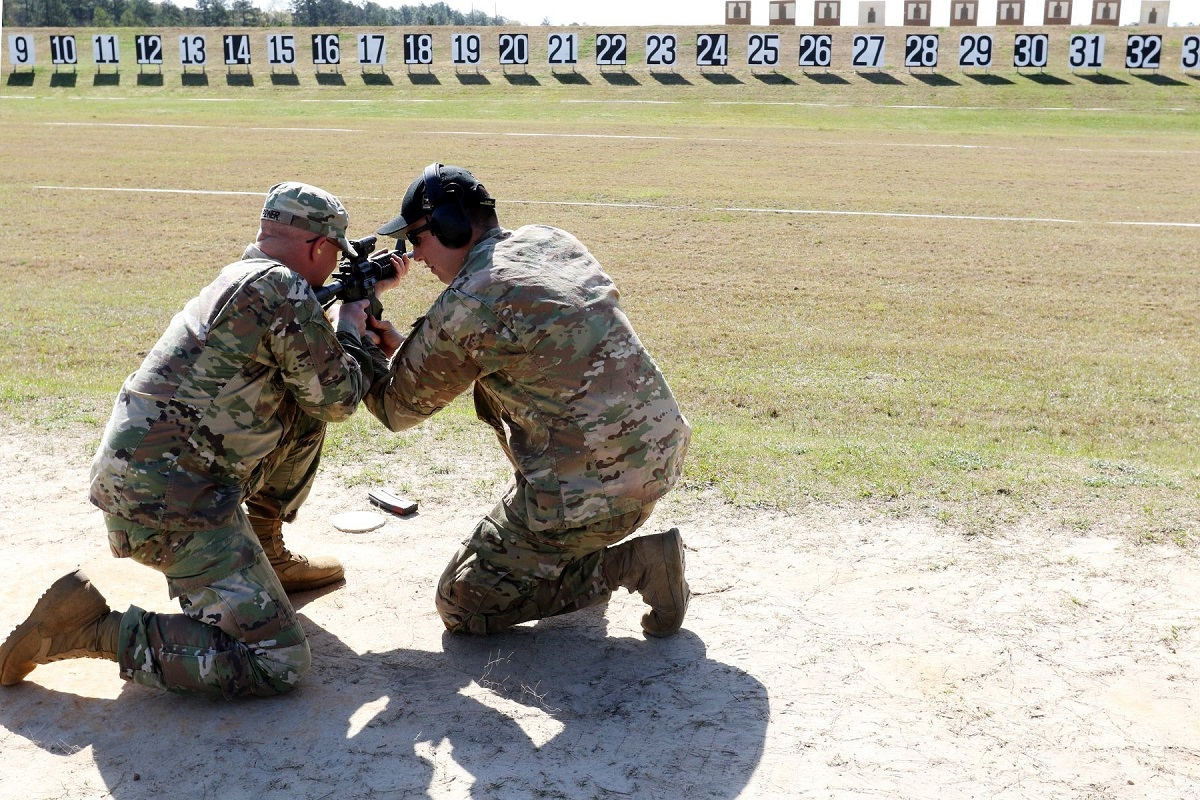 Soldier joins elite ranks of triple-distinguished shooters at Army shooting match