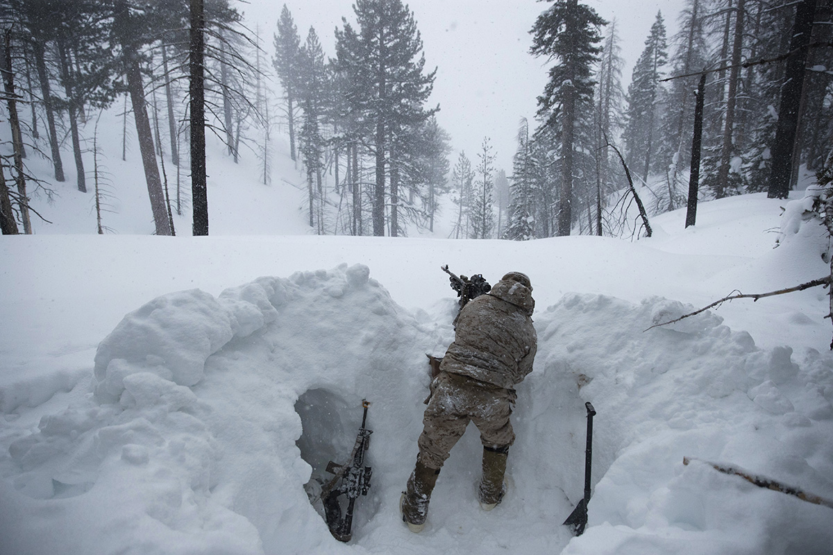 A U.S. Marine covers a machine gun in a trench while preparing for advanced cold-weather training at the Marine Corps Mountain Warfare Training Center on Saturday, Feb. 9, 2019, in Bridgeport, Calif. After 17 years of war against Taliban and al-Qaida-linked insurgents, the military is shifting its focus to better prepare for great-power competition with Russia and China, and against unpredictable foes such as North Korea and Iran. (Jae C. Hong/AP)