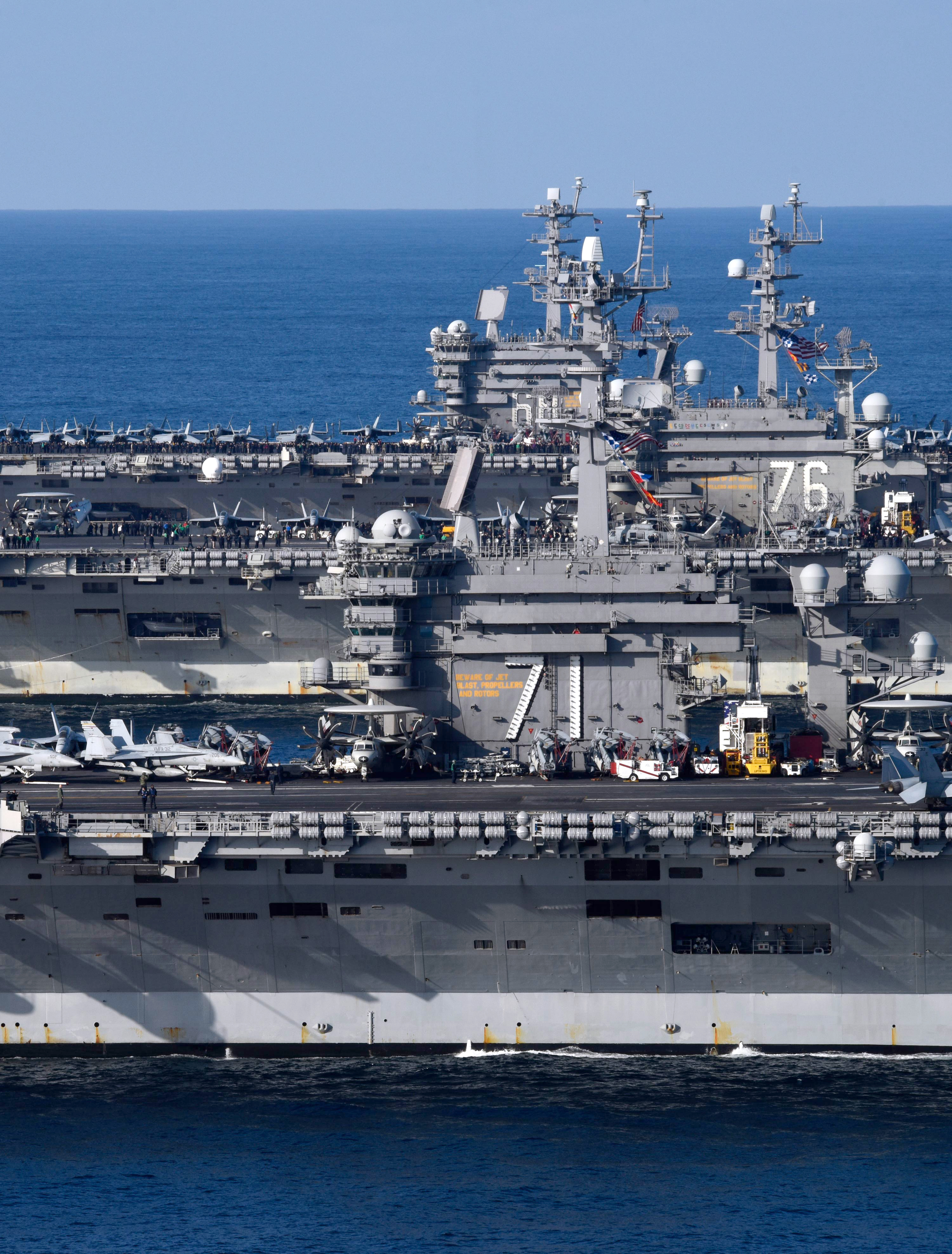 The aircraft carriers USS Ronald Reagan, USS Theodore Roosevelt and USS Nimitz transit the western Pacific. The strike groups are underway and conducting operations in international waters as part of a three-carrier strike force exercise. (MC3 Anthony J. Rivera/Navy)