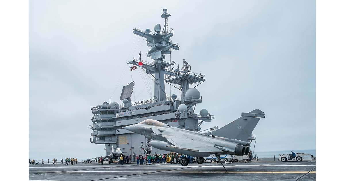 At Sea on the USS George H. W. Bush (May 10. 2018) Hook down, a French Navy Rafale Marine fighter aircraft prepares to catch the number two wire trap on the aircraft carrier George H. W. Bush for a near perfect trap, during joint US and French carrier flight operations May 10. (photo by Mark D. Faram/staff)