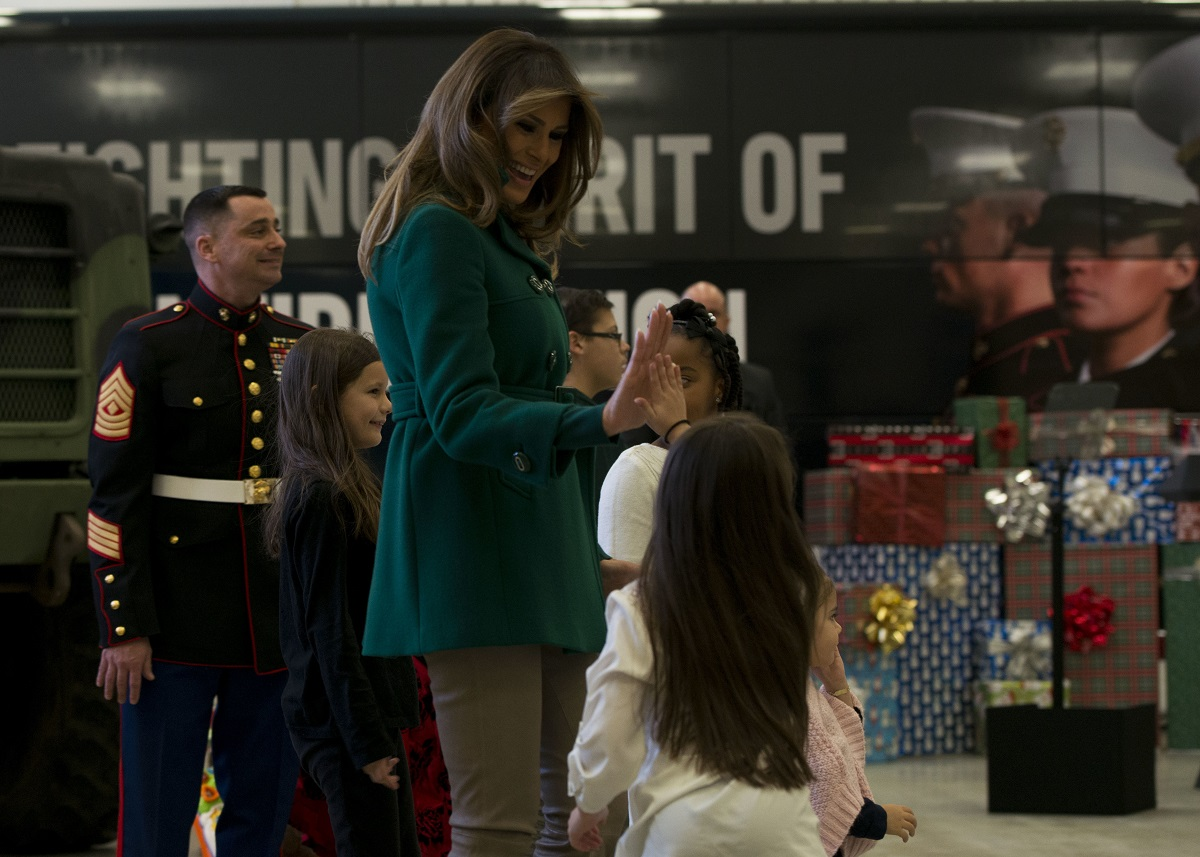 First lady Melania Trump high fives a child during the annual Marine Corps Foundation's Toys for Tots event Dec. 13, 2017, on Joint Base Anacostia-Bolling. Trump helped children make cards, sorted toys and greeted military families at the event. (MC2 Jason Amadi/Navy)