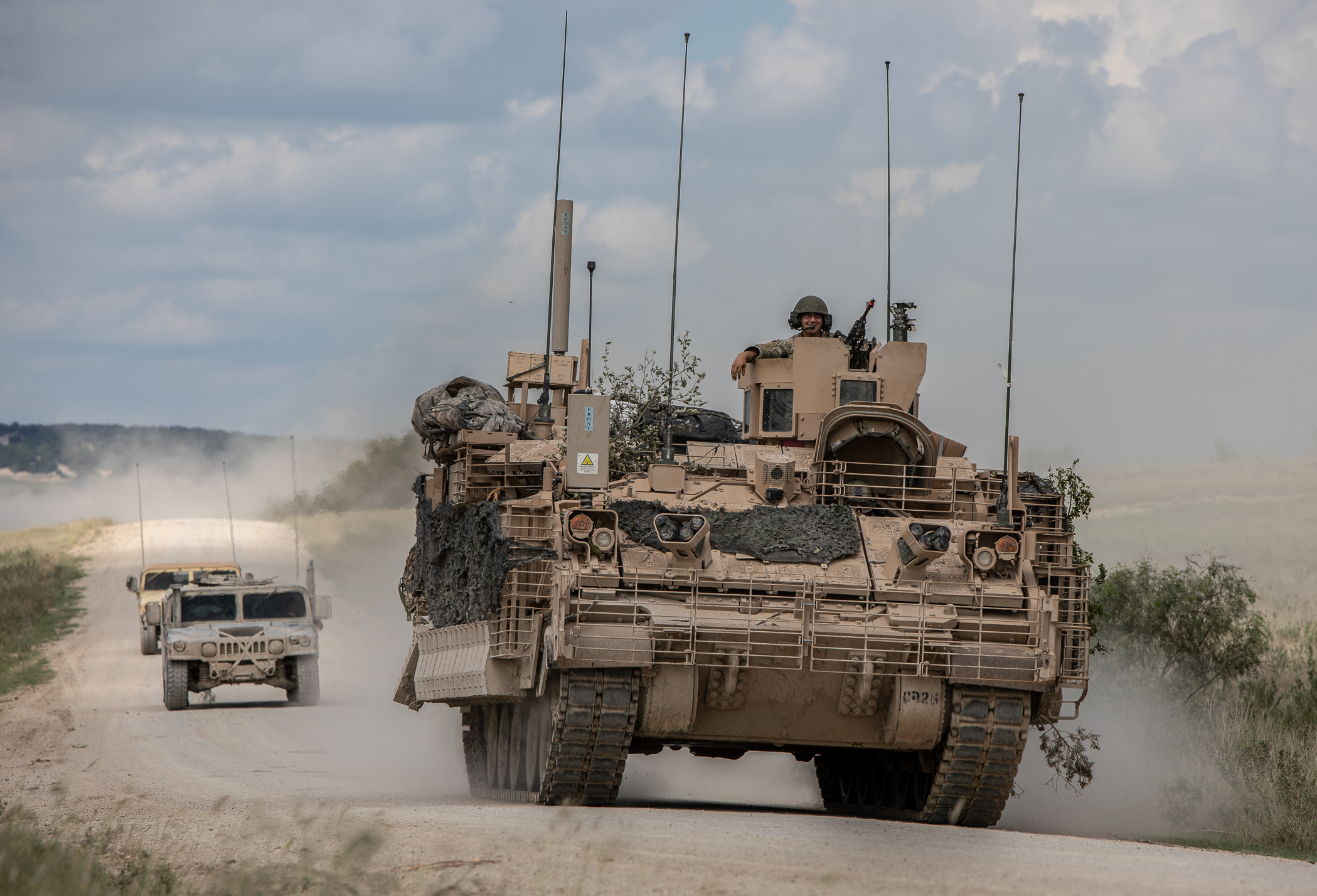 """Soldiers from 9th U.S. Cavalry Regiment """"Dark Horse,"""" 2nd Armored Brigade Combat Team, 1st Cavalry Division, are escorted by observer controllers from the Army Operational Test Command after completing field testing of the Armored Multi-Purpose Vehicle. (Maj. Carson Petry/Army)"""