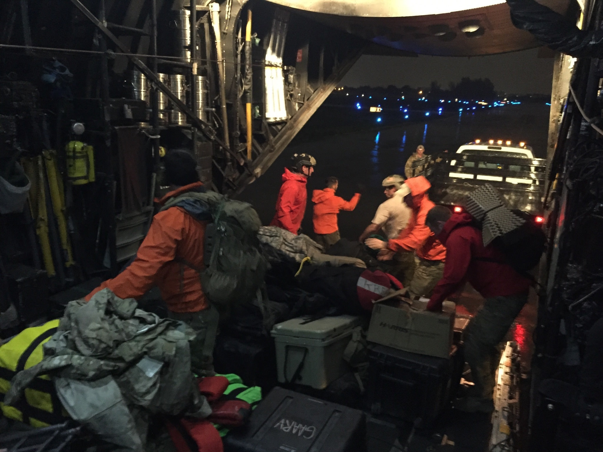 U.S. Air Force Guardian Angel pararescuemen from the 121st Rescue Squadron, Alaska Air National Guard, unload their equipment from an MC130P Combat Shadow aircraft assigned with the 129th Rescue Wing, California Air National Guard at Miami Opa Locka Executive Airport, Fla., as Hurricane Irma approaches Sept. 9, 2017. The Guardian Angel team are prepositioning themselves and staging equipment 20 miles outside of Miami in a safety bunker rated for a Category 5 hurricane in order to have immediate capability once the storm passes to begin personnel recovery operations. (Tech. Sgt. Joseph Prouse/Air National Guard)