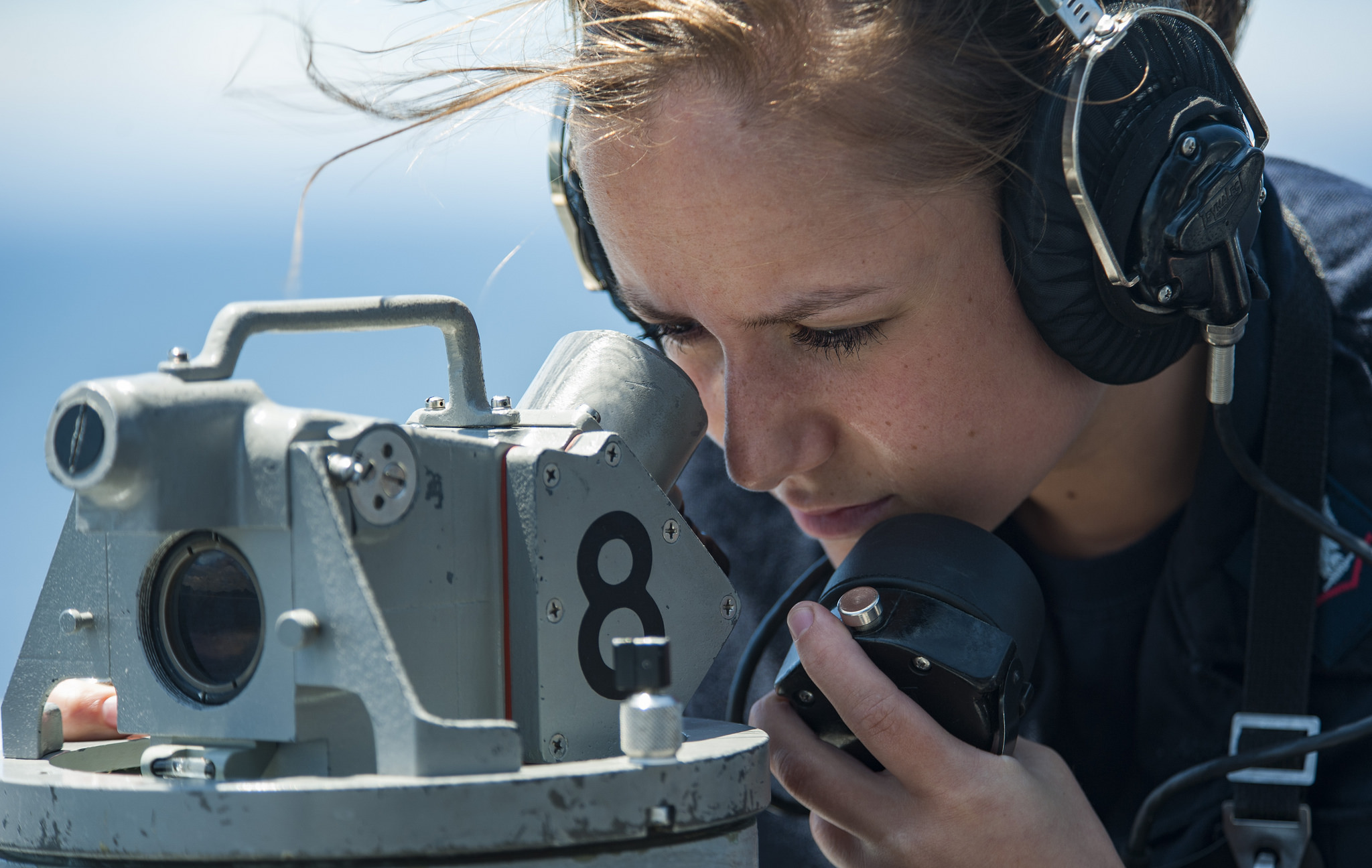 Quartermaster 3rd Class Meghin Warren reads bearings from a telescopic alidade aboard the amphibious assault ship USS Wasp (LHD 1). Wasp is transiting to Sasebo, Japan to conduct a turnover with the USS Bonhomme Richard (LHD 6) as the forward-deployed flagship of the amphibious forces in the U.S. 7th Fleet area of operations. (Mass Communication Specialist 3rd Class Levingston Lewis/Navy)