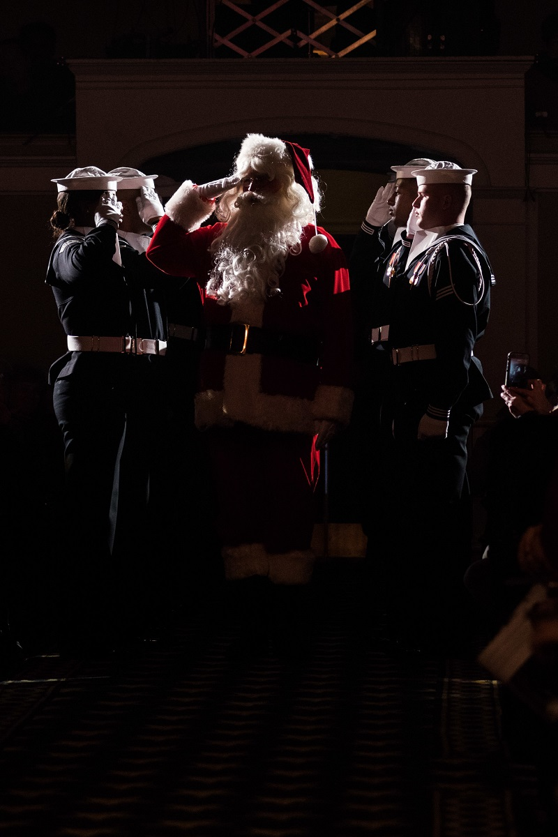 Santa Claus arrives at the United States Navy Band's annual holiday concert Dec. 17, 2017, at DAR Constitutional Hall in Washington. (Musician 1st Class Jonathan Barnes/Navy)