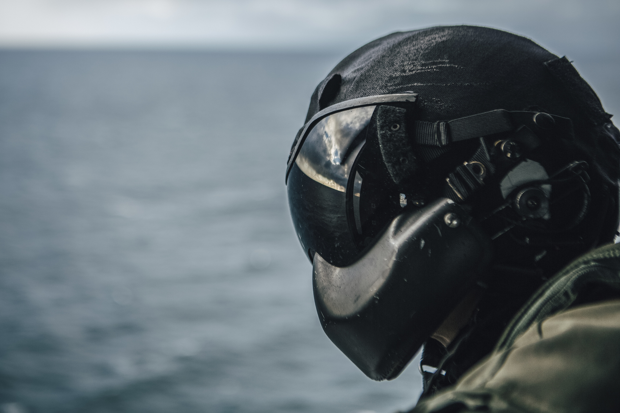 Marine Corps Sgt. Cade Allen, a UH-1Y Venom crew chief, scans the horizon during flight operations in the Pacific Ocean, Feb. 20, 2019. (Lance Cpl. Jason Monty/Marine Corps)