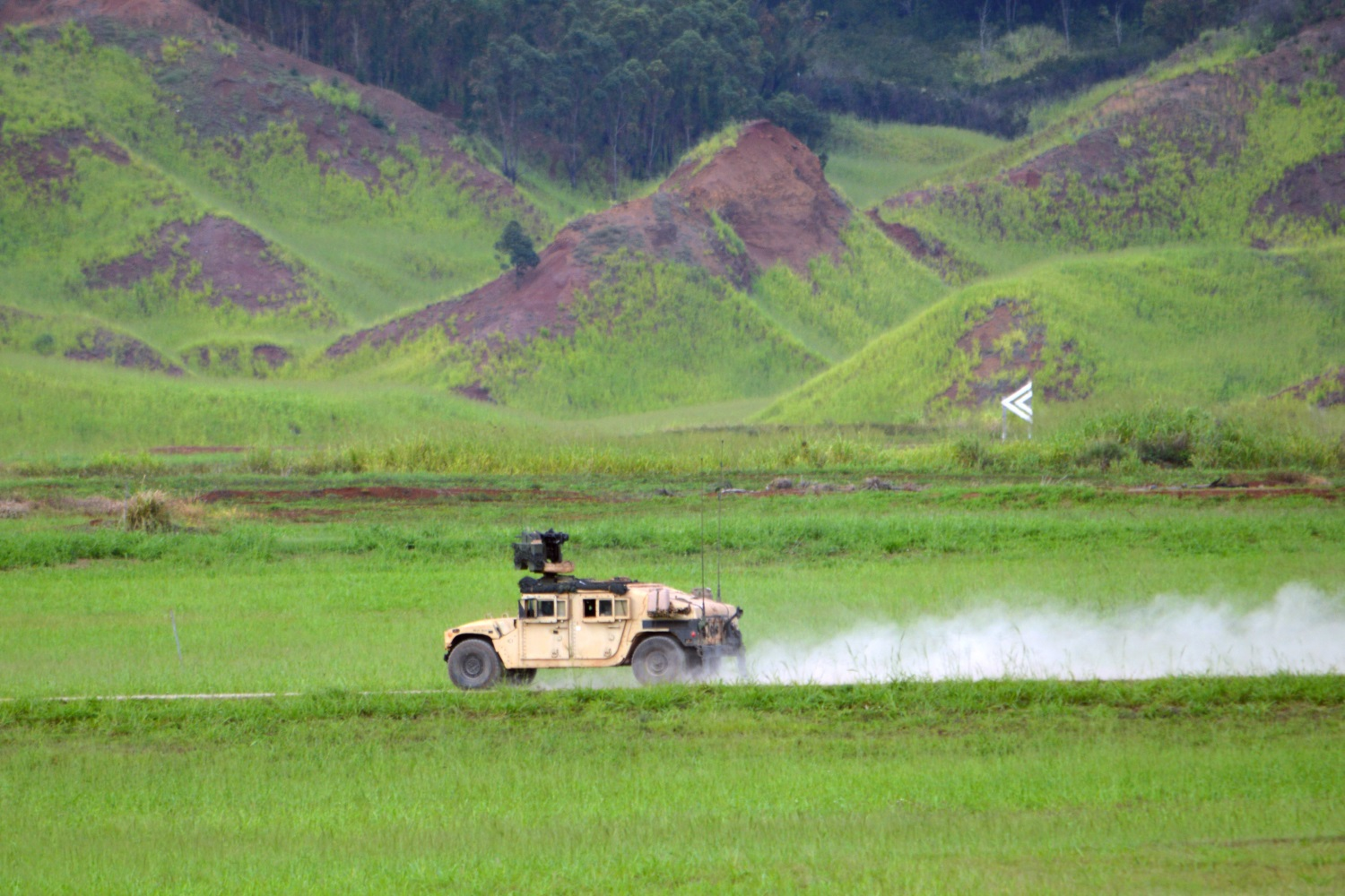Soldiers assigned to the 3rd Brigade Combat Team, 25th Infantry Division, race their M115A1 HMWVV to the next target to engage it with an M153 Common Remotely Operated Weapon Station (CROWS) at the Battle Area Complex (BAX), Schofield Barracks, Hawaii, on Nov. 7, 2107. The soldiers participated in a crew gunnery to qualify with their weapon systems before depart for the Joint Readiness Training Center located at Fort Polk, La., next year. (Staff Sgt. Armando R. Limon/Army)