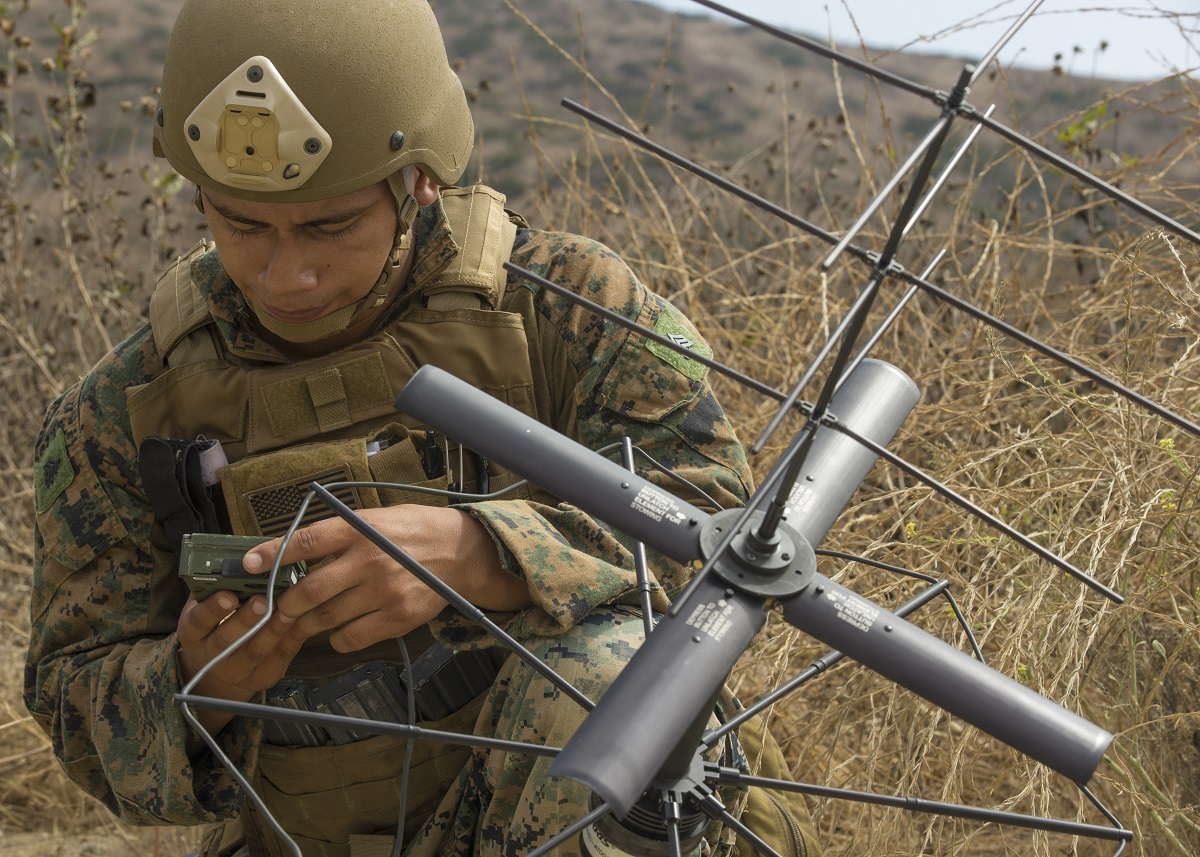 U.S. Marine Corps Sgt. Emmanuel Ramirez, a communications chief, assembles a Satellite Communications Antenna during a simulated patrol on Camp Pendleton, Calif. August 22, 2017. 1st Air Naval Gunfire Liaison Company is conducting training to prepare Marines for future deployments. (Pfc. Dalton S. Swanbeck/U.S. Marine Corps)