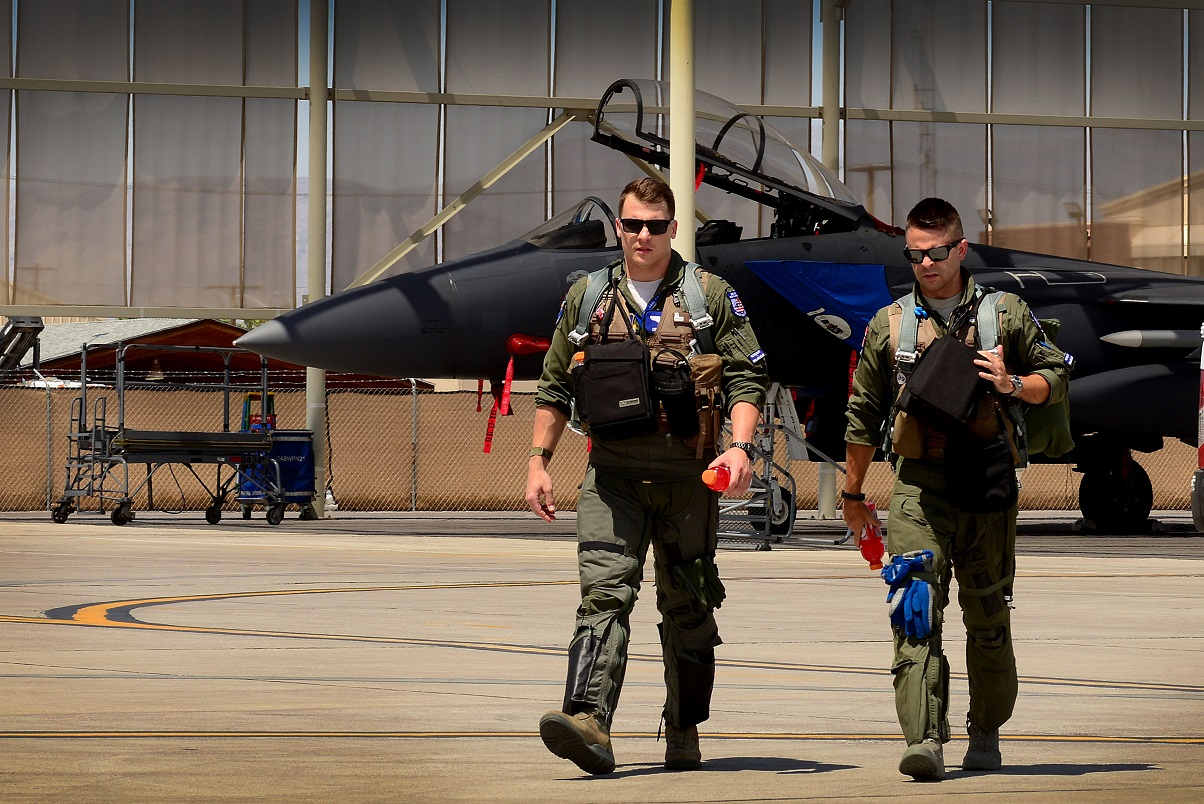 First Lt. Drew Lyons, an F-15E Strike Eagle pilot, and weapon systems officer 1st Lt. J. Paul Reasner, both of the 492nd Fighter Squadron, step to their aircraft for a sortie in support of exercise Red Flag 16-4 at Nellis Air Force Base, Nev., Aug 17. (Tech. Sgt. Matthew Plew/Air Force)