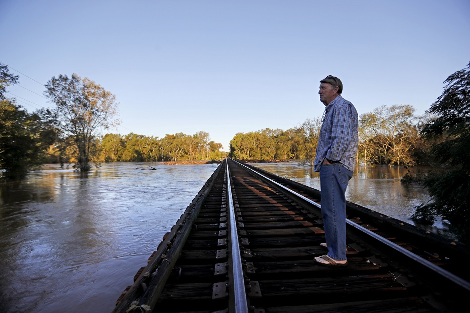 Charles Gardner checks the level of the Cape Fear River near his property after its projected time of cresting in Fayetteville, N.C., on Sept. 19, 2018. Veterans Affairs officials say they are hopeful clinics in the region will be able to reopen shortly after the floodwaters go down. (David Goldman/AP)