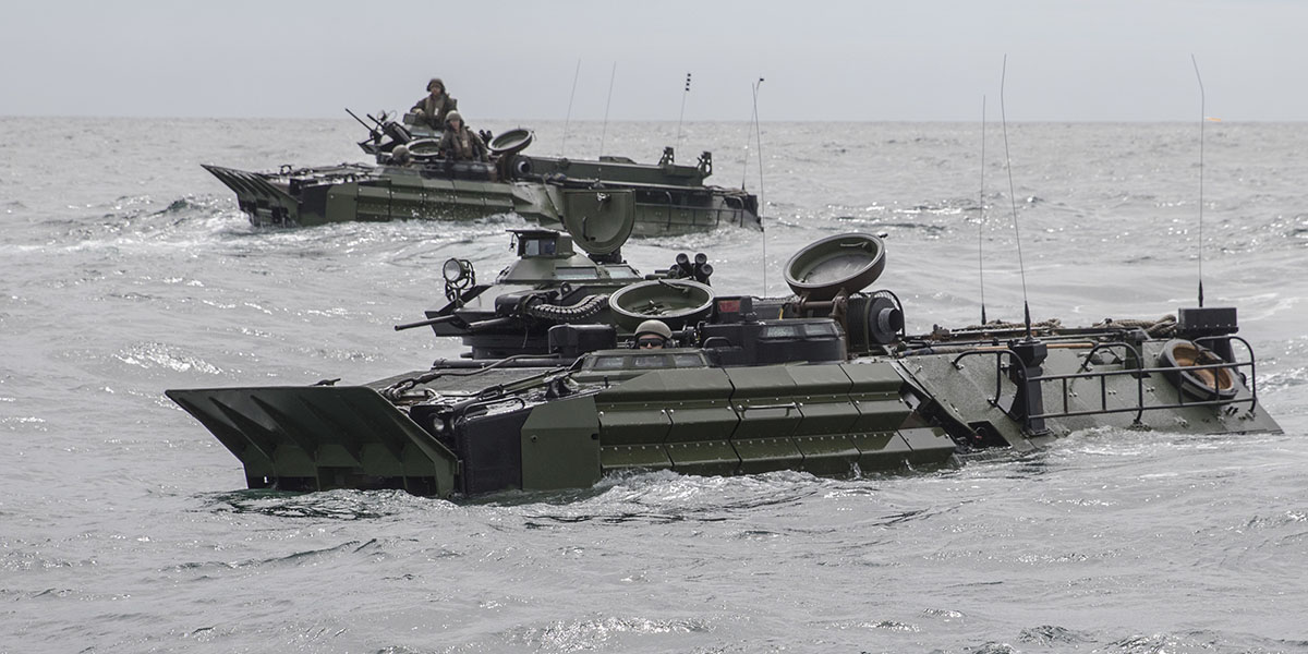 Amphibious assault vehicles assigned to 2nd Assault Amphibian Battalion make their way to the warship Bataan. (Mass Communication Specialist 2nd Class Zachary A. Anderson/Navy)