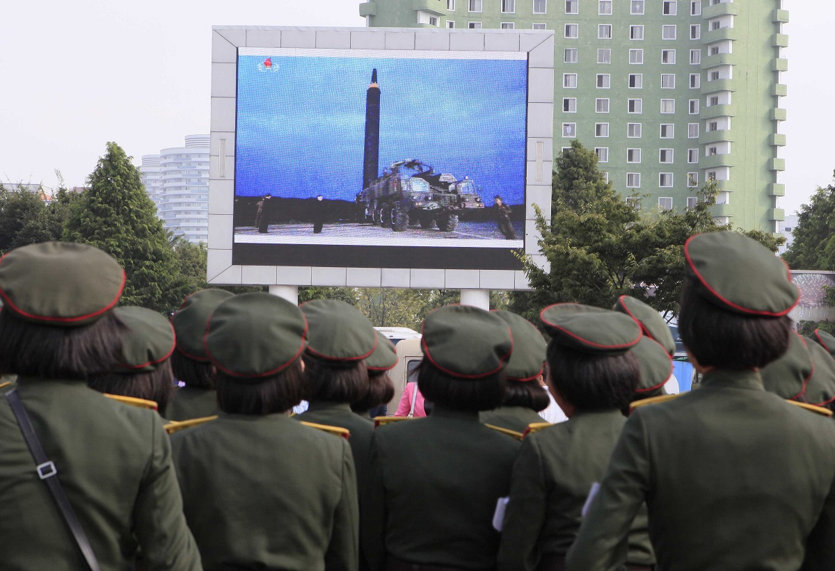 People fill the square of the main railway station to watch a televised news broadcast of the test-fire of the ICBM Hwasong-12 on Aug. 30, 2017, in Pyongyang, North Korea. Fired on Aug. 28, North Korea fired a Hwasong-12 over the northern Japanese island of Hokkaido. (Kim Kwang Hyon/AP)