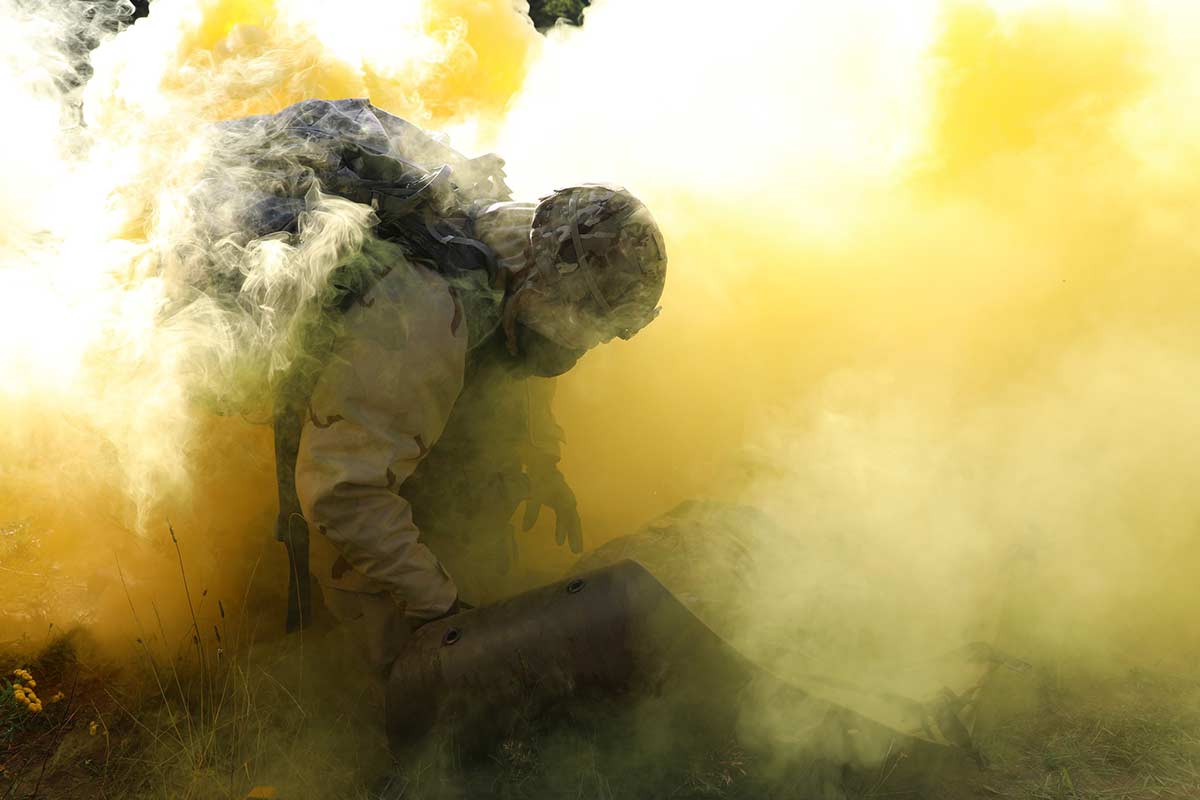 U.S. Army Sgt. 1st Class Christopher Moore secures a simulated casualty on a sked while under a simulated chemical, biological, radiological and nuclear attack during the 21st Theater Sustainment Command Best Medic Competition in Baumholder, Germany, Aug. 22, 2019. (Sgt. Jesse Pilgrim/Army)