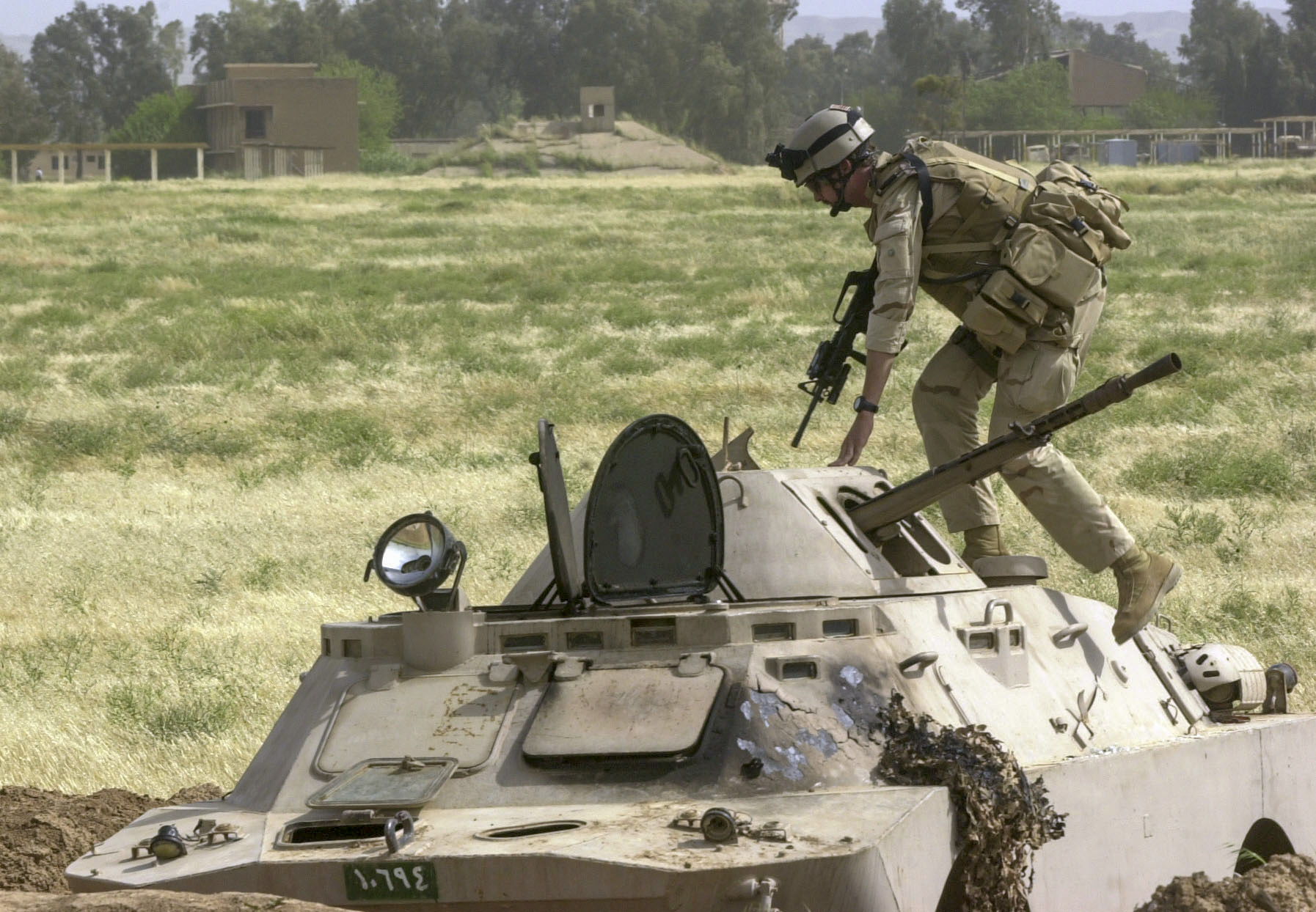 Staff Sgt. Dan Hunter, from Georgia, a member of a U.S. Air Force Global Airfield Assesment Team (GAAT) from McGuire AFB in New Jersey, checks to make sure that an Iraqi armored vehical was clear while surveying a captured Iraqi Helicopter/Air Base on the outskirts of Kirkuk. The GAAT team measured and tested the quality of the runways and parking ramps to see if they could support the weight of heavy aircraft for use by the US military. (Alan Lessig/Air Force Times)