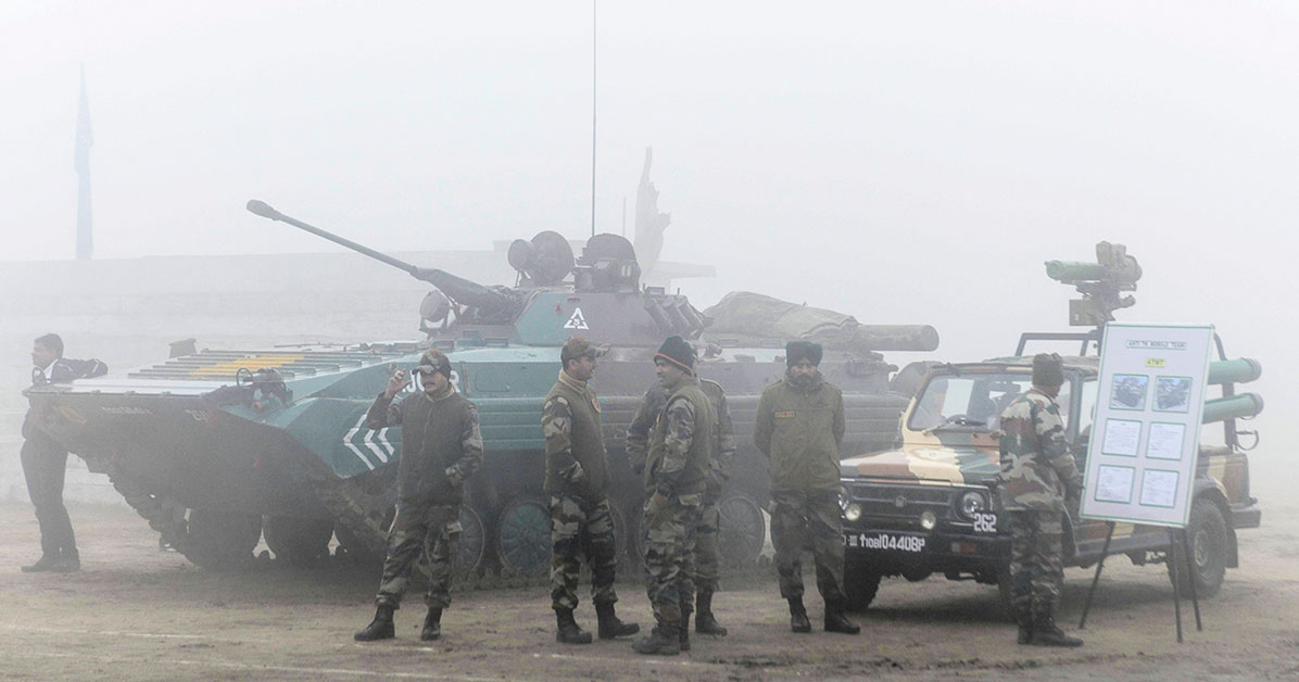India Army personnel stand near a tank under heavy foggy conditions during an exhibition to commemorate the Army Day at Panther Stadium in Amritsar on January 15, 2020. (NARINDER NANU/AFP via Getty Images)