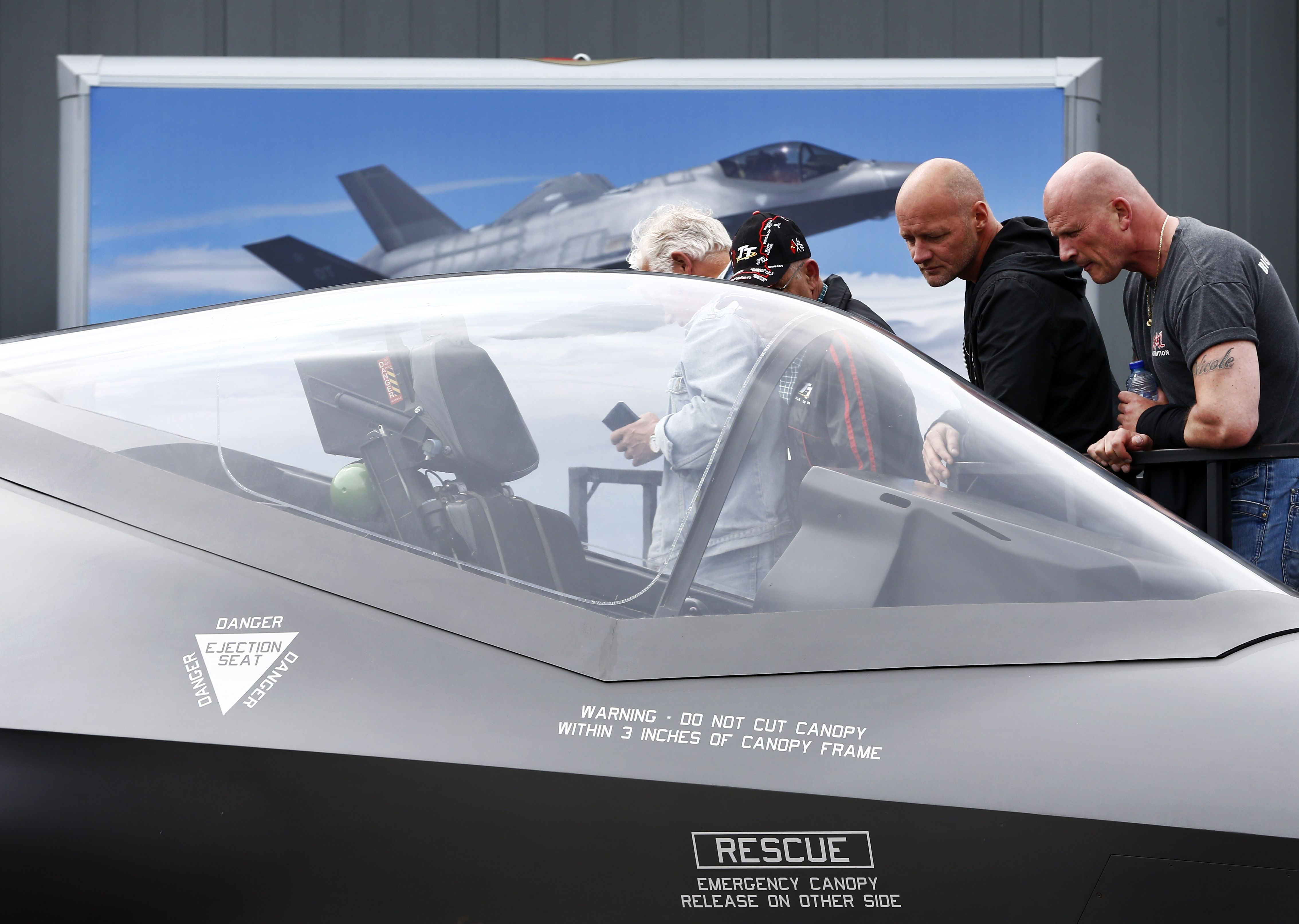 Visitors examine a replica of the Dutch F-35C Lightning II joint striker fighter aircraft during the Dutch Air Force Days at Leeuwarden Air Base in Leeuwarden on June 10, 2016. (Photo credit Vincent Jannink/AFP/Getty Images)