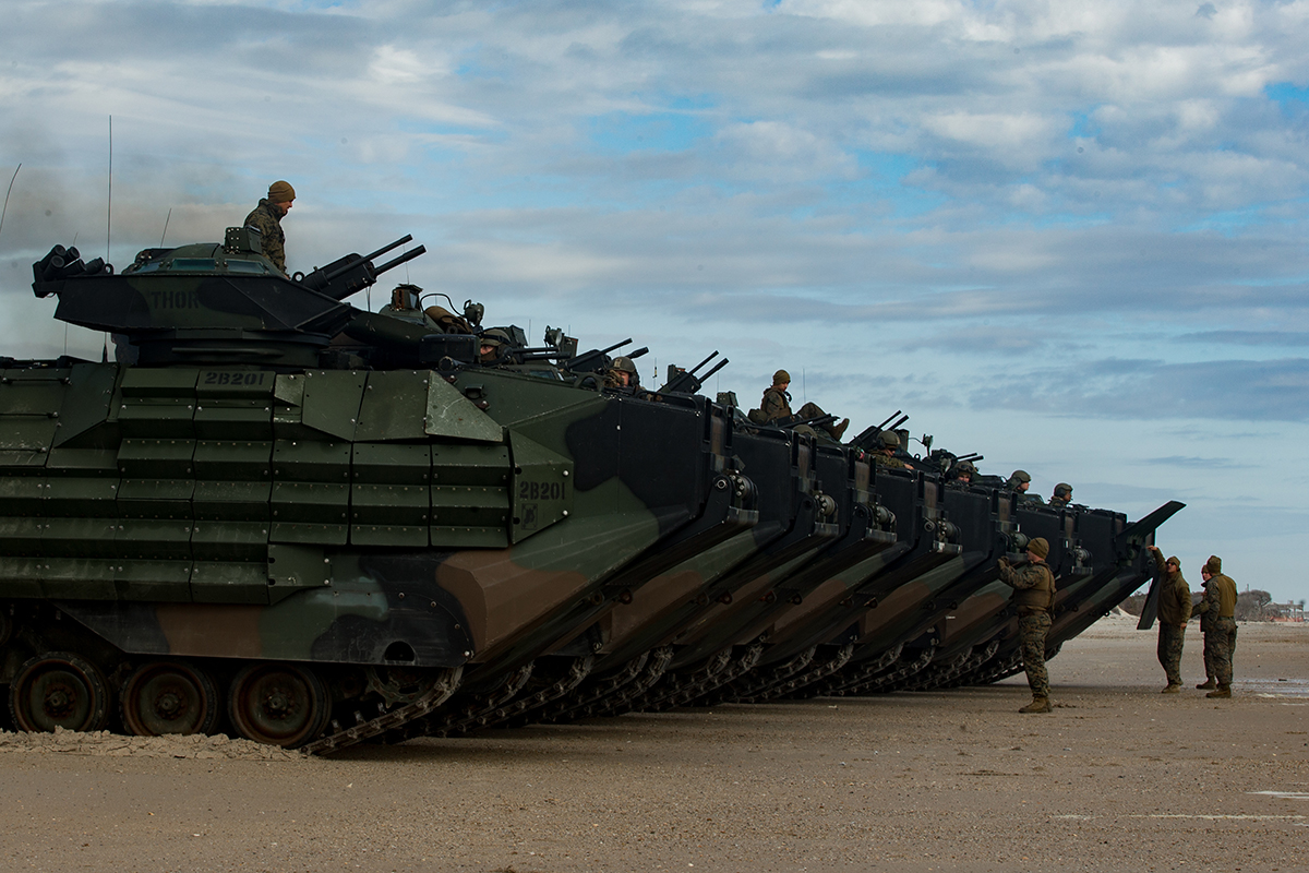 Marines with the Amphibious Assault Vehicle Platoon, 1st Battalion 2nd Marine Regiment, 22nd Marine Expeditionary Unit, stage prior to embarking on the Wasp-class amphibious assault ship USS Kearsarge (LHD 3), on Onslow Beach, Camp Lejeune, N.C., Dec. 19, 2018. (Lance Cpl. Damion Hatch Jr./Marine Corps)