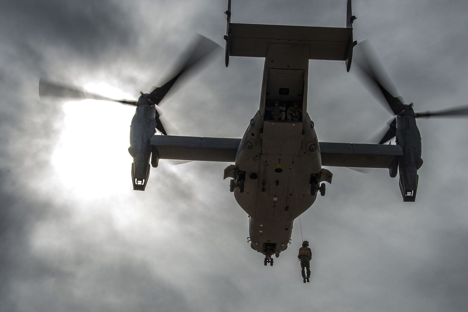 A CV-22 Osprey, assigned to the 20th Special Operations Squadron, hoists up a simulated survivor during combat search and rescue training at Cannon Air Force Base, N.M., March 7, 2019. (Staff Sgt. Luke Kitterman/Air Force)