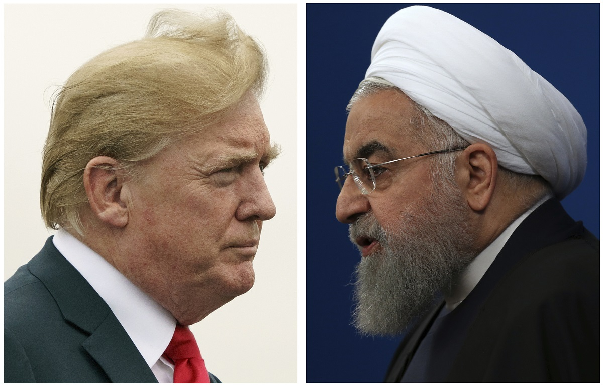 U.S. President Donald Trump, left, in August 2018 reactivated economic sanctions on Iran after leaving a multilateral Iran nuclear deal because the deal did not ban Iran's testing of ballistic missiles.