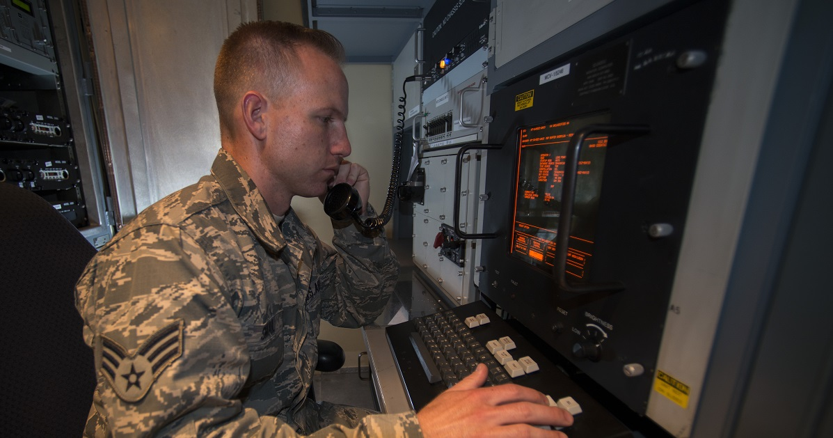 Senior Airman Jonathan R. Smail, a transmission technician from the 233d Space Communications Squadron, Colorado Air National Guard, monitors computer systems in a mobile satellite trailer at Greeley Air National Guard Station, Greeley Colo., in June 2015. Smail troubleshoots and maintains satellite communications electronic equipment for the 233rd's one of a kind mobile nuclear and missile launch tracking mission. (Tech. Sgt. Wolfram M. Stumpf/Air Force)