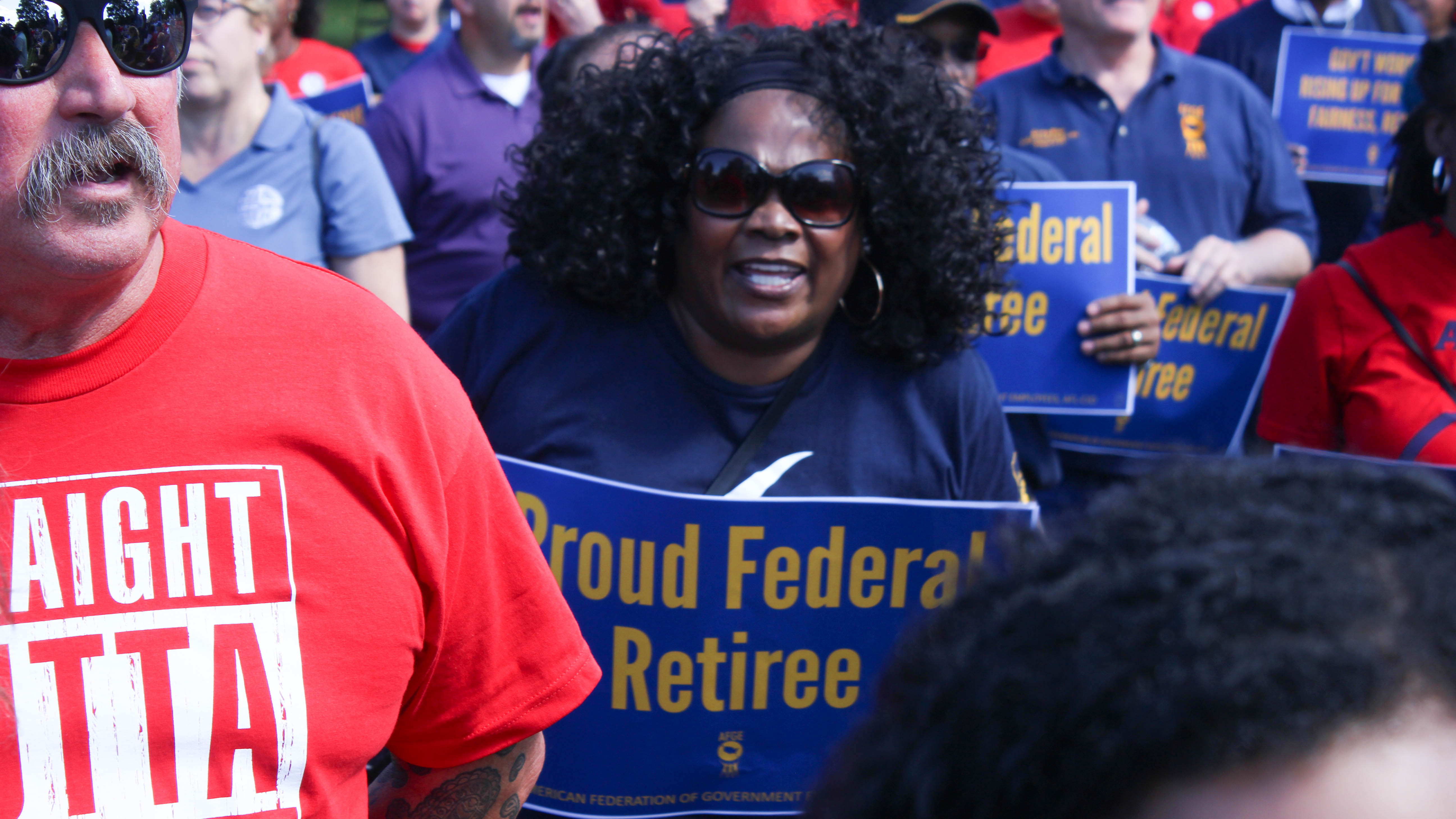 A former federal employee joins the Sept. 24 protest outside the U.S. Capitol building for union rights. (Jessie Bur/Staff)