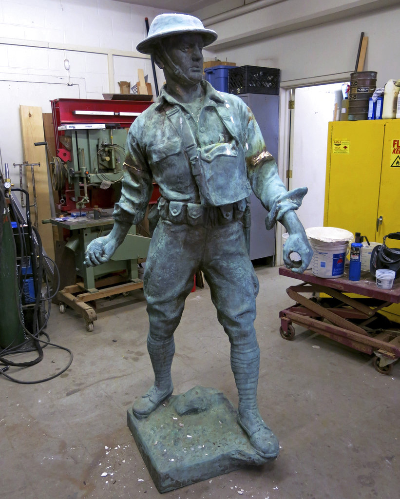 In this March 30, 2016, photo provided by NYC Parks, the World War I Highbridge Doughboy statue is repaired at the NYC Parks monument repair facility in the Brooklyn borough of New York. World War I monuments nationwide have been forgotten about and fallen into disrepair. The centennial of America's involvement in World War I has drawn attention to the state of disrepair of many monuments honoring soldiers, galvanizing efforts to fix them. (NYC Parks via AP)