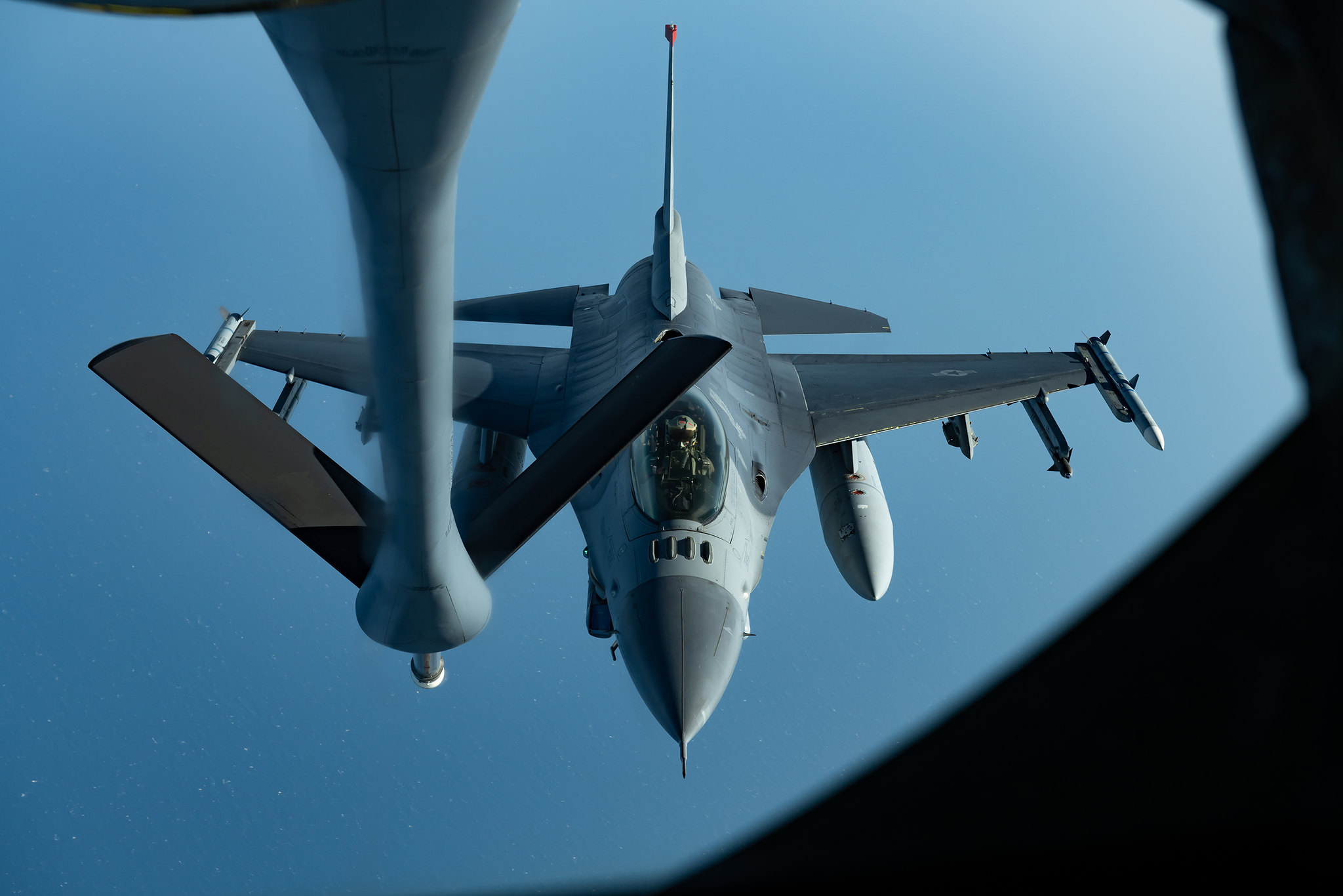 An F-16CM Fighting Falcon prepares to refuel with a KC-135 Stratotanker during a routine training exercise off the coast of Japan, May 8, 2019. (Airman 1st Class Matthew Seefeldt/Air Force)