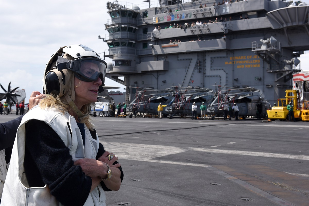 Jamie McCourt, U.S. ambassador to the French Republic and Principality of Monaco, observes flight operations aboard the Truman. (U.S. Navy)