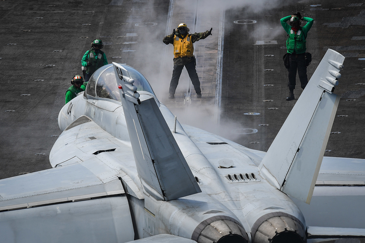 Sailors direct an F/A-18F Super Hornet on June 30, 20109, on the flight deck of the aircraft carrier USS Theodore Roosevelt (CVN 71) in the Pacific Ocean. (Mass Communication Specialist Seaman Olympia O. McCoy/Navy)