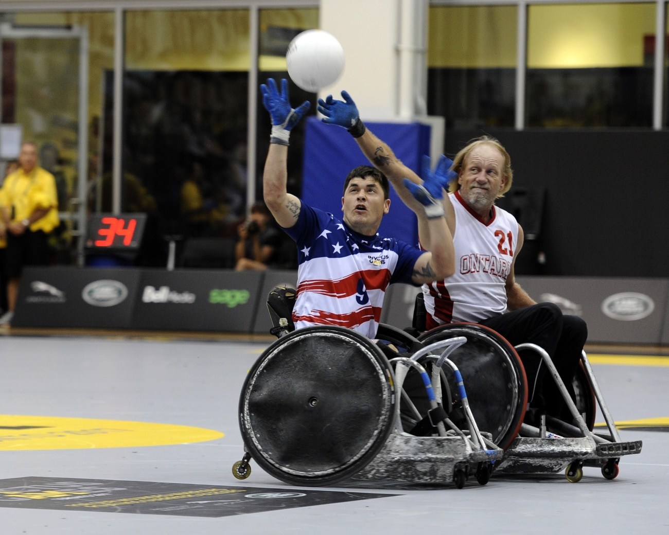 U.S. Marine Corps Sgt. Ivan Sears intercepts a pass during a wheelchair rugby match against the Italian team during the 2017 Invictus Games at the Mattamy Athlethics Centre in Toronto, Canada, on Sept. 27, 2017. The Invictus Games are the sole international adaptive sporting event for injured active-duty and veteran service members. (Staff Sgt. Jannelle McRae/Air Force)