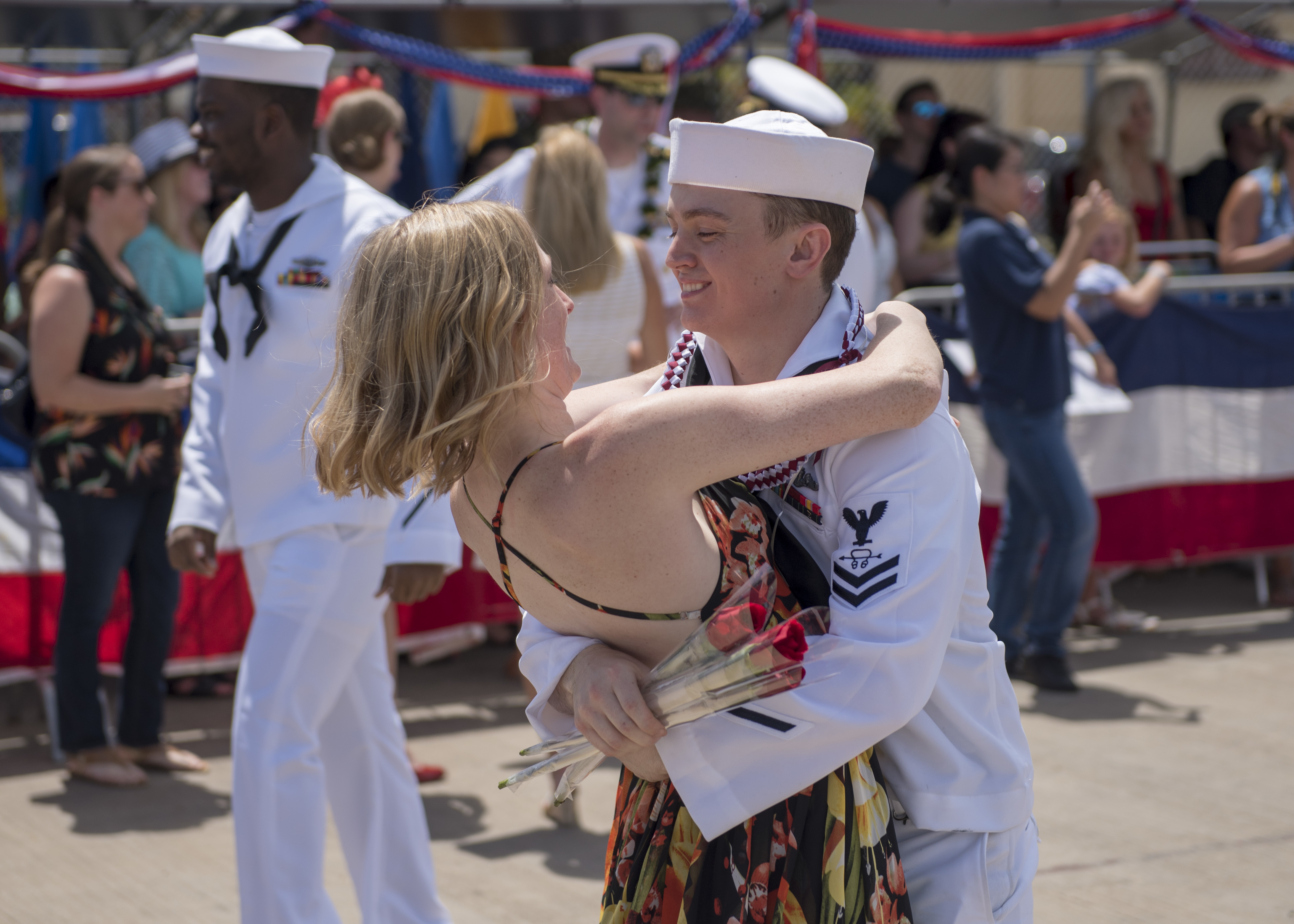 STS2 Michael Mize, assigned to the Virginia-class fast-attack submarine USS Mississippi (SSN 782), hugs his loved one during a homecoming ceremony in Joint Base Pearl Harbor-Hickam, March 30. Mississippi successfully completed a six-month Western Pacific deployment. (MC2 Michael H. Lee/ Navy)