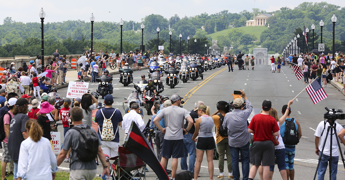 Riders in the Rolling Thunder Memorial Day motorcycle procession ride across the Memorial Bridge, with Arlington National Cemetery in the background as they enter Washington, D.C. on Sunday, May 27, as part of the annual remembrance festivities in the city. (Ben Murray / Military Times)