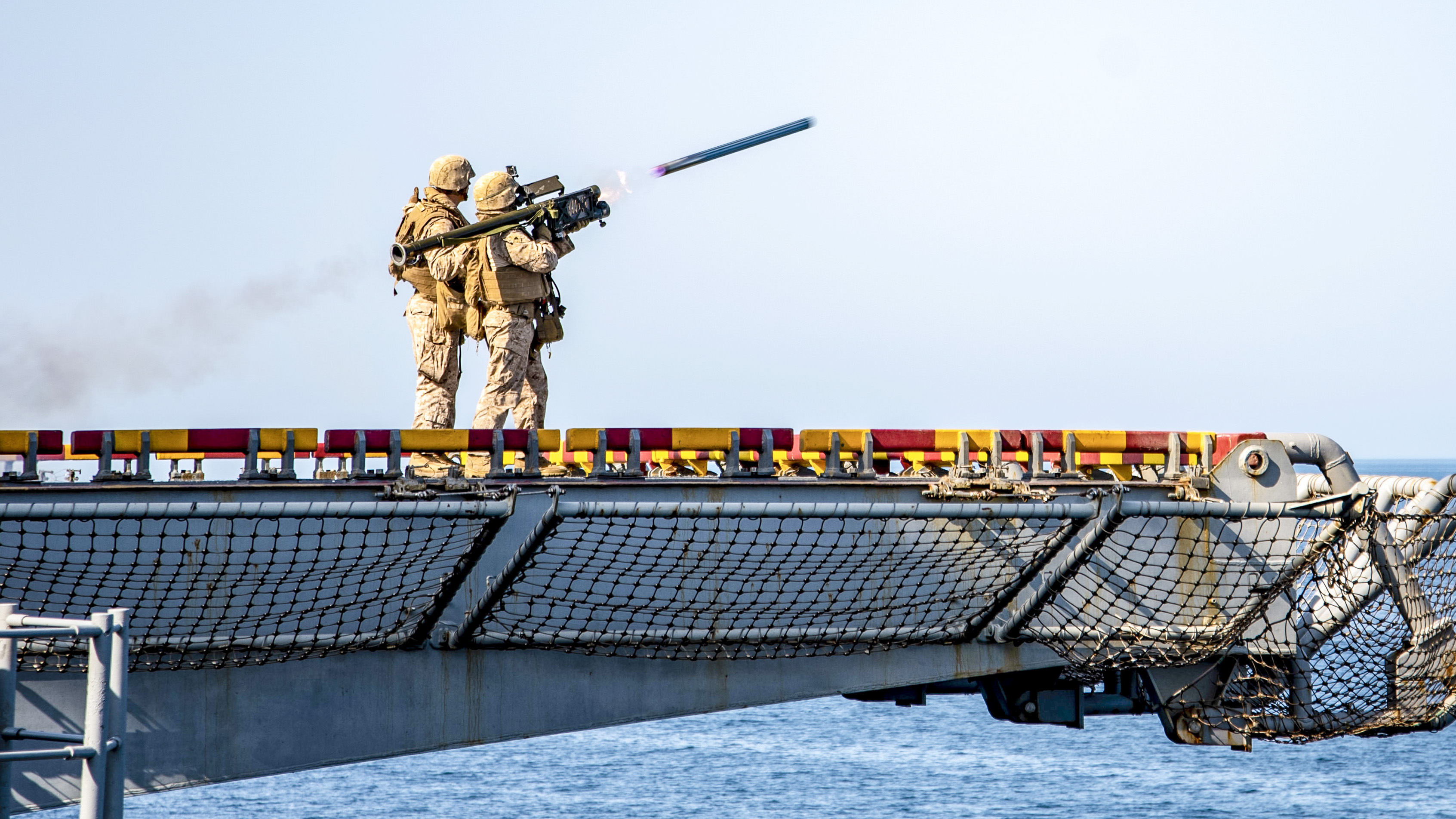 Marine Corps Sgt. Jade Woodend, assigned to Battalion Landing Team 3/1, fires a FIM-92 Stinger from the flight deck of the Wasp-class amphibious assault ship USS Essex (LHD 2) during a scheduled deployment with the Essex Amphibious Ready Group (ARG) and 13th Marine Expeditionary Unit (MEU). (MC3 Jenna Dobson/Navy)