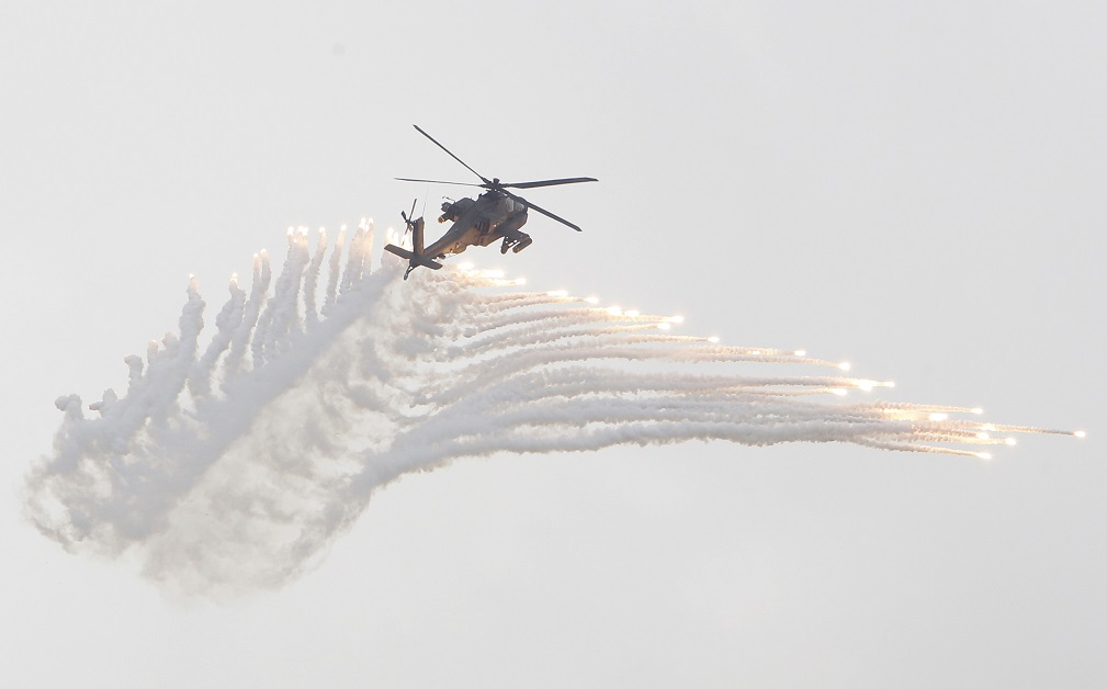 Flares launch from a Taiwanese AH-1W Cobra attack helicopter during exercises at an air base in Taichung County, Taiwan, on June 7, 2018. (Chiang Ying-ying/AP)