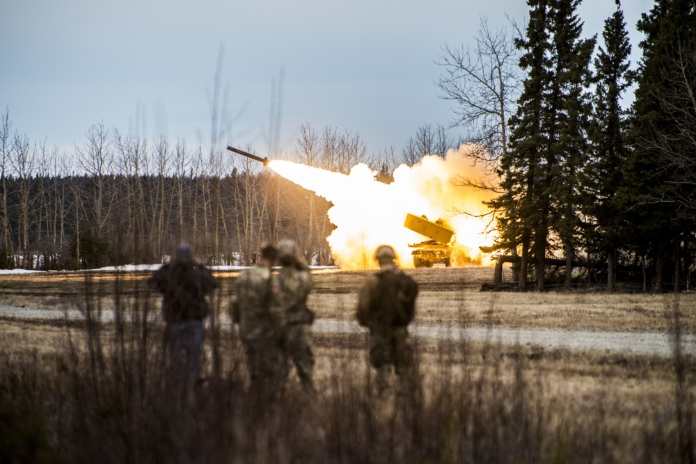 U.S. Army Soldiers from the 18th Field Artillery Brigade fire a M142 High Mobility Artillery Rocket System (HIMARS) during a HIMARS rapid infiltration mission for Red Flag-Alaska 18-1 on May 4, 2018, at Fort Greely, Alaska. U.S. Navy, Army and Air Force coordinated during the mission. (Senior Airman Isaac Johnson/U.S. Air Force)