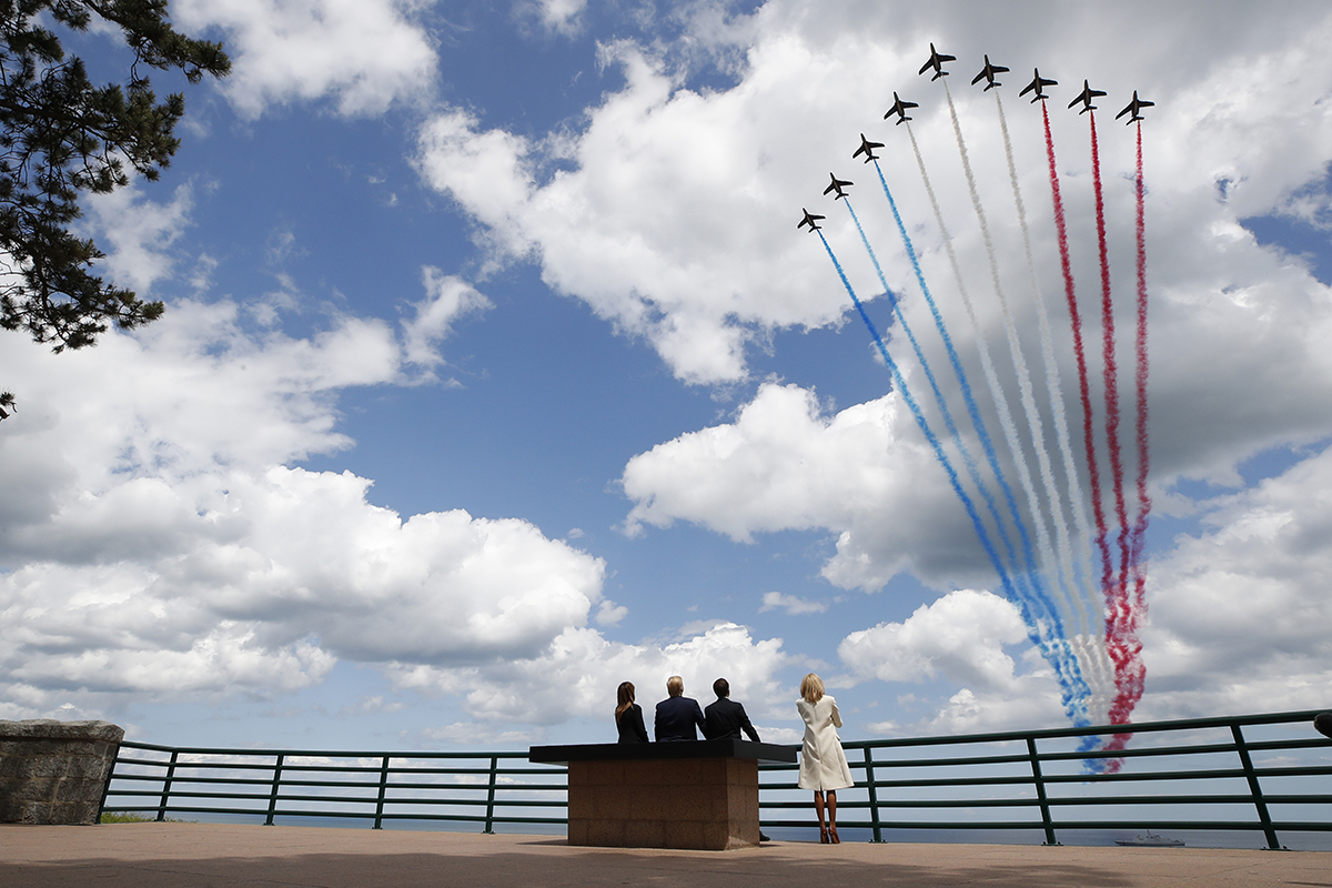 President Donald Trump, first lady Melania Trump, French President Emmanuel Macron and Brigitte Macron, watch a flyover during a ceremony to commemorate the 75th anniversary of D-Day at the American Normandy cemetery, Thursday, June 6, 2019, in Colleville-sur-Mer, Normandy, France. (Alex Brandon/AP)