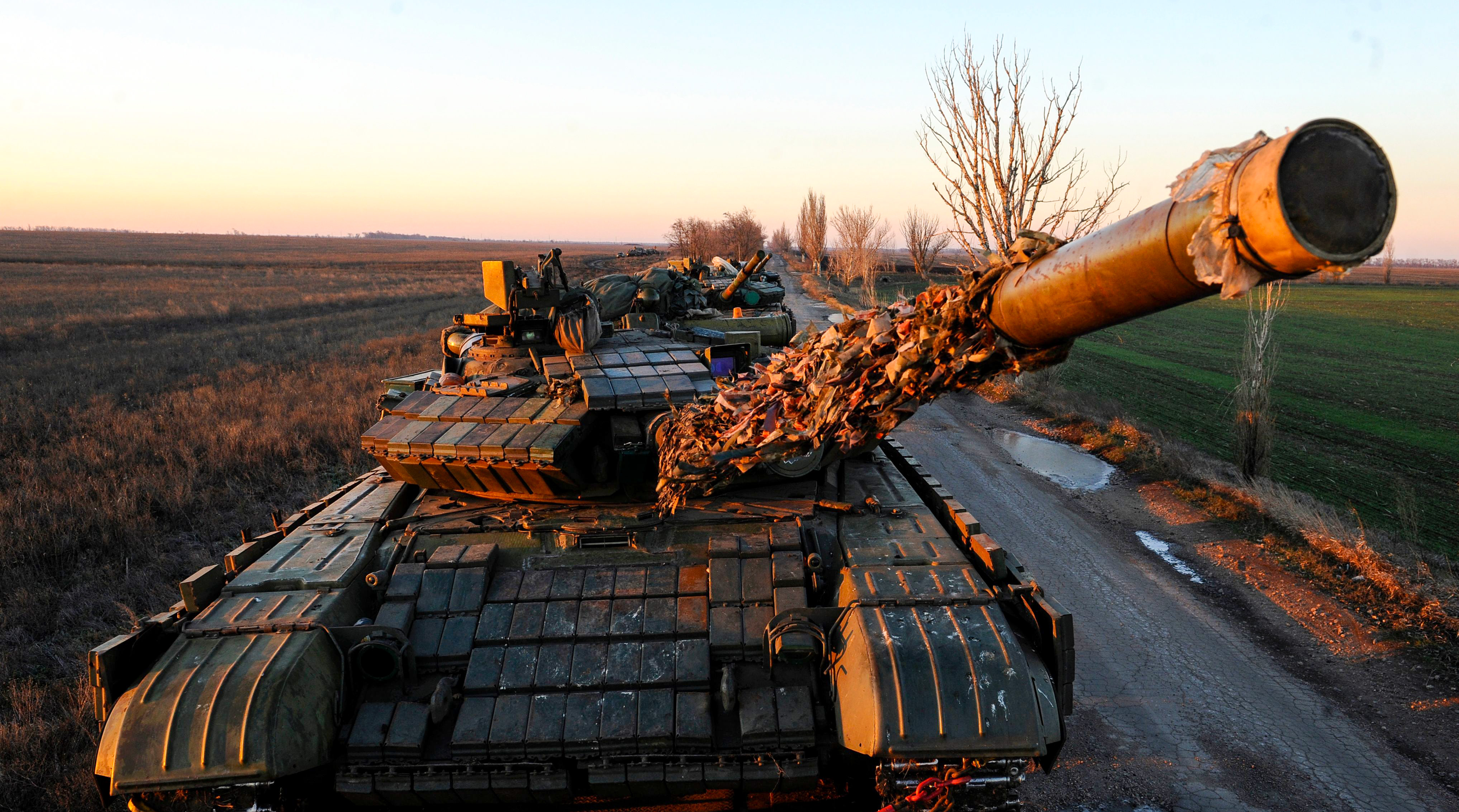A picture taken near Urzuf village not far from the city of Mariupol, eastern Ukraine on November 29, 2018 shows Ukrainian tanks during military drills. - Ukraine's president imposed martial law in border regions on November 28, 2018 for 30 days in 10 regions bordering Russia, the Black Sea and the Azov Sea, after Russian forces seized three of Kiev's ships off the coast of Crimea on November 25, sparking the most dangerous crisis between the ex-Soviet neighbours in years. (PSEGA VOLSKII/AFP/Getty Images)