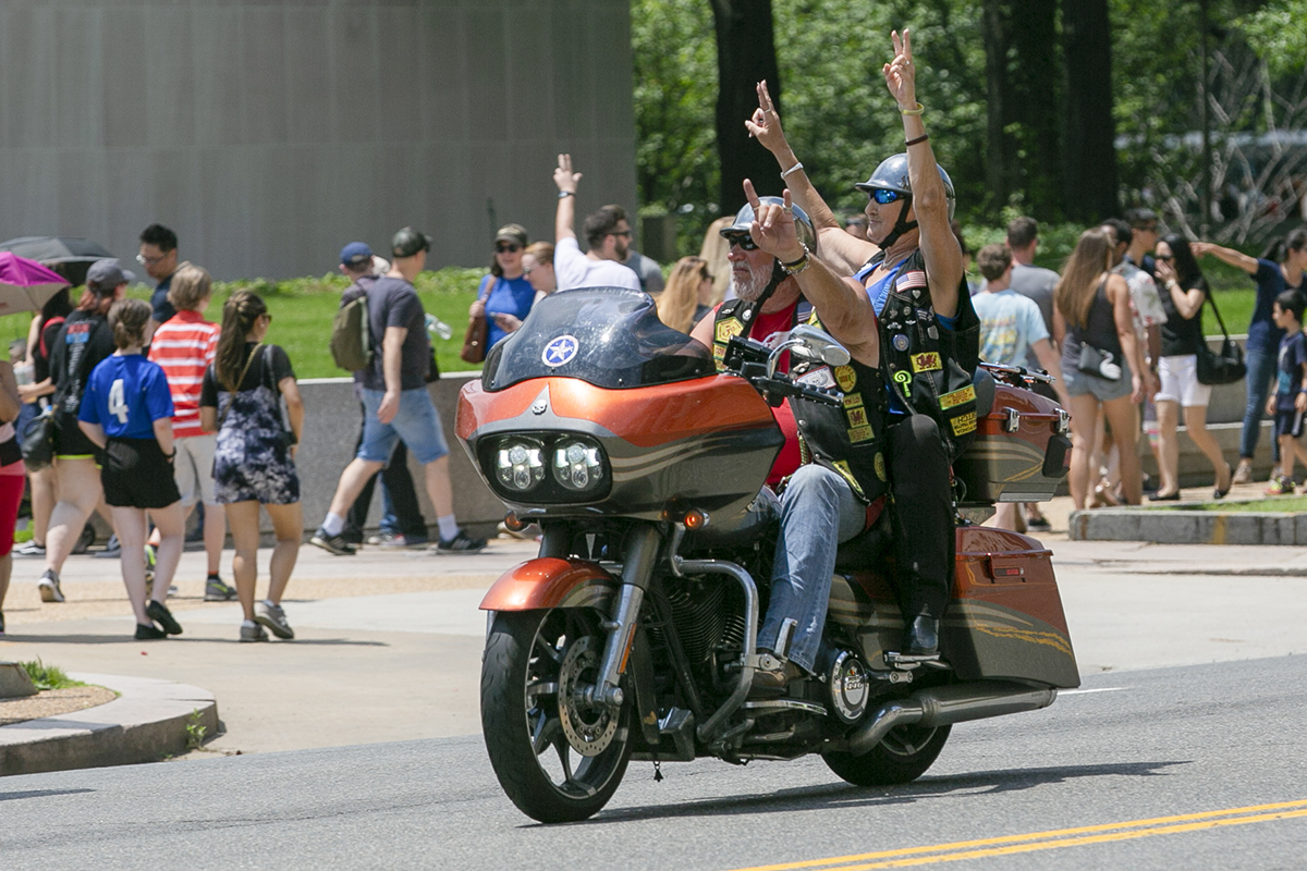 Riders wave to the large crowd during Rolling Thunder XXXI First Amendment Demonstration Run along Constitution Ave. in Washington, DC on Sunday May 27, 2018. Motorcycle riders from across the nation, rode a designated route through the Mall area of Washington, D.C. The event is an actual demonstration/protest to bring awareness and accountability for POWs and MIAs left behind.(Alan Lessig/Staff)