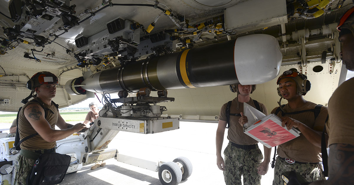 Aviation Ordnancemen assigned to the ÒSkinny DragonsÓ of Patrol Squadron (VP) 4 load a Mark 54 torpedo on a P-8A Poseidon aircraft during a proficiency exercise on Kadena Air Base, Okinawa Japan. VP-4 is deployed to the U.S. 7th Fleet area of operation conducting Intelligence, Surveillance, and Reconnaissance (ISR) and Anti-Submarine Warfare (ASW) missions as well as providing maritime domain awareness throughout the Indo-Pacific region. (MC2 Juan S. Sua/Navy)