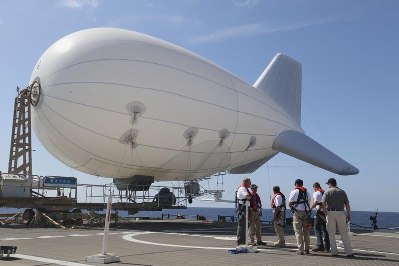 Aerostar's TIF-25K Aerostat -- essentially a tethered blimp that's capable of doing everything from weather research to intelligence work -- is prepared by her ground crew for deployment during tests of concept for using the blimp to counter drug smugglers. It could also help with access control. (Mark D. Faram)
